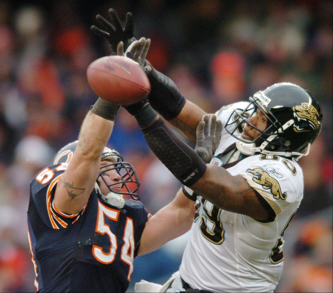 Brian Urlacher of the Bears breaks up a long pass to Marcedes Lewis of the Jaguars.