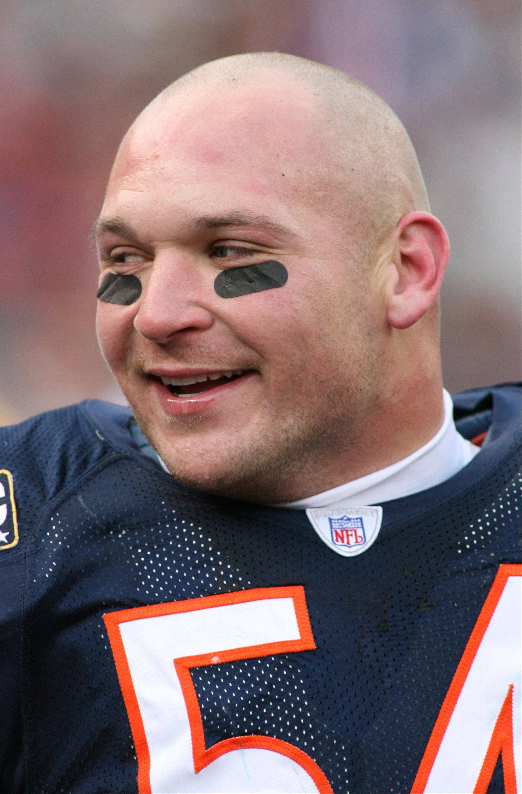 Brian Urlacher is all smiles against the Green Bay Packers.