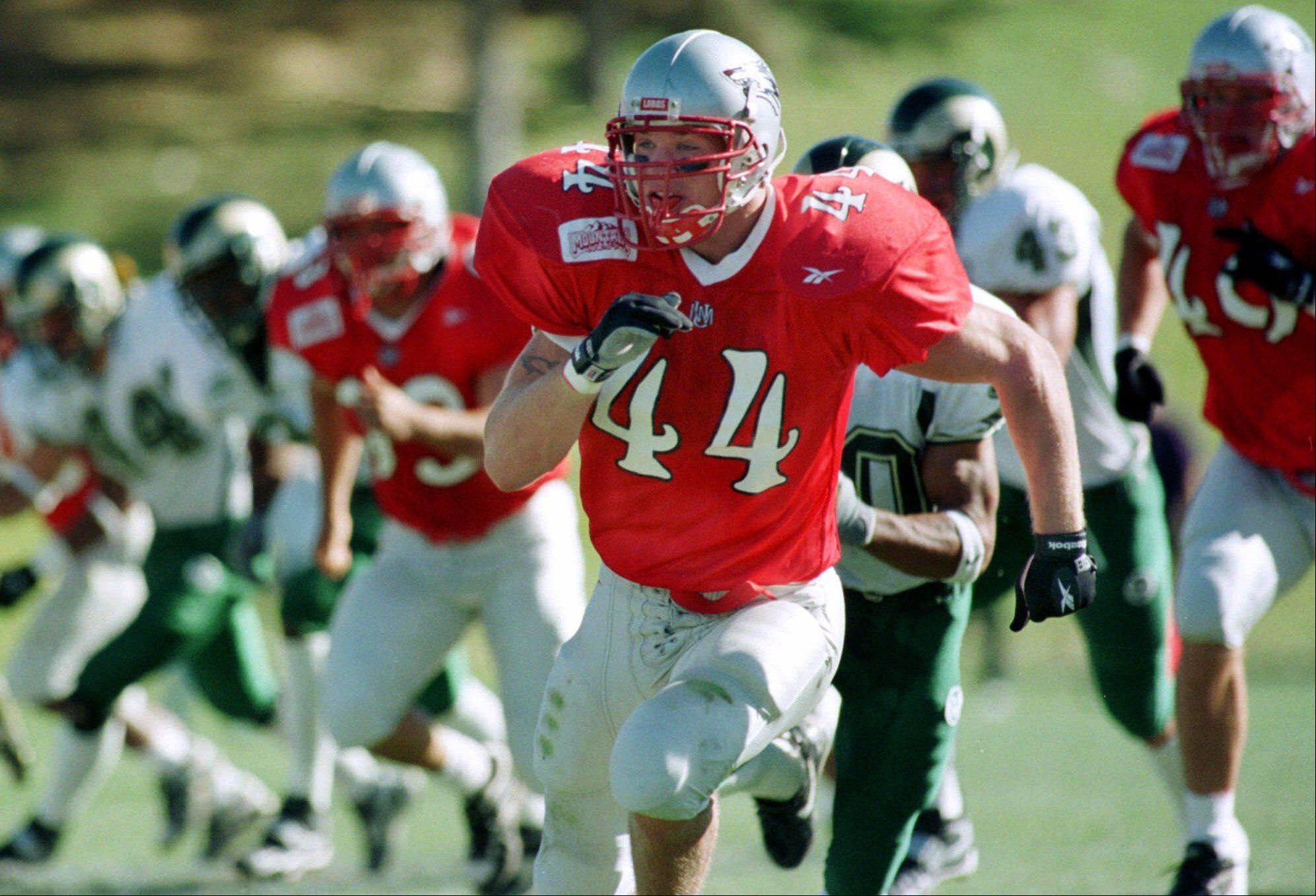 New Mexico's Brian Urlacher (44) leads the charge downfield during punt coverage by UNM against Colorado State on Saturday, Nov. 6, 1999 at University Stadium in Albuquerque, N.M. Urlacher, who plays both offense and defense for UNM, will be a probable first round NFL draft choice and could be the highest draft pick ever out of UNM.