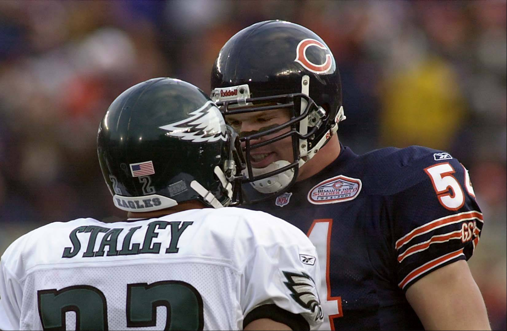 Brian Urlacher goes head to head with Duce Staley.
