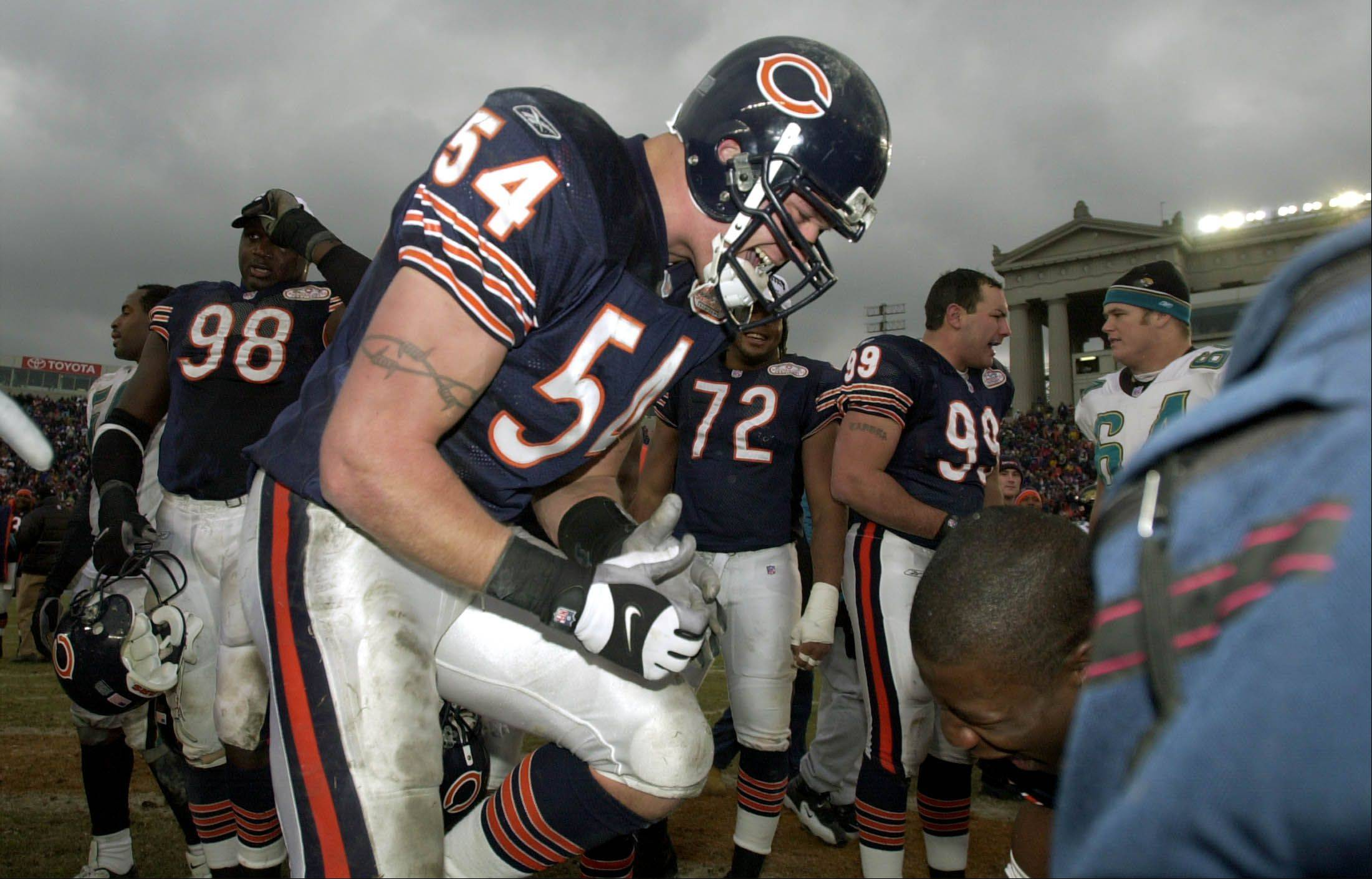 Chicago Bears linebacker Brian Urlacher celebrates on the field.