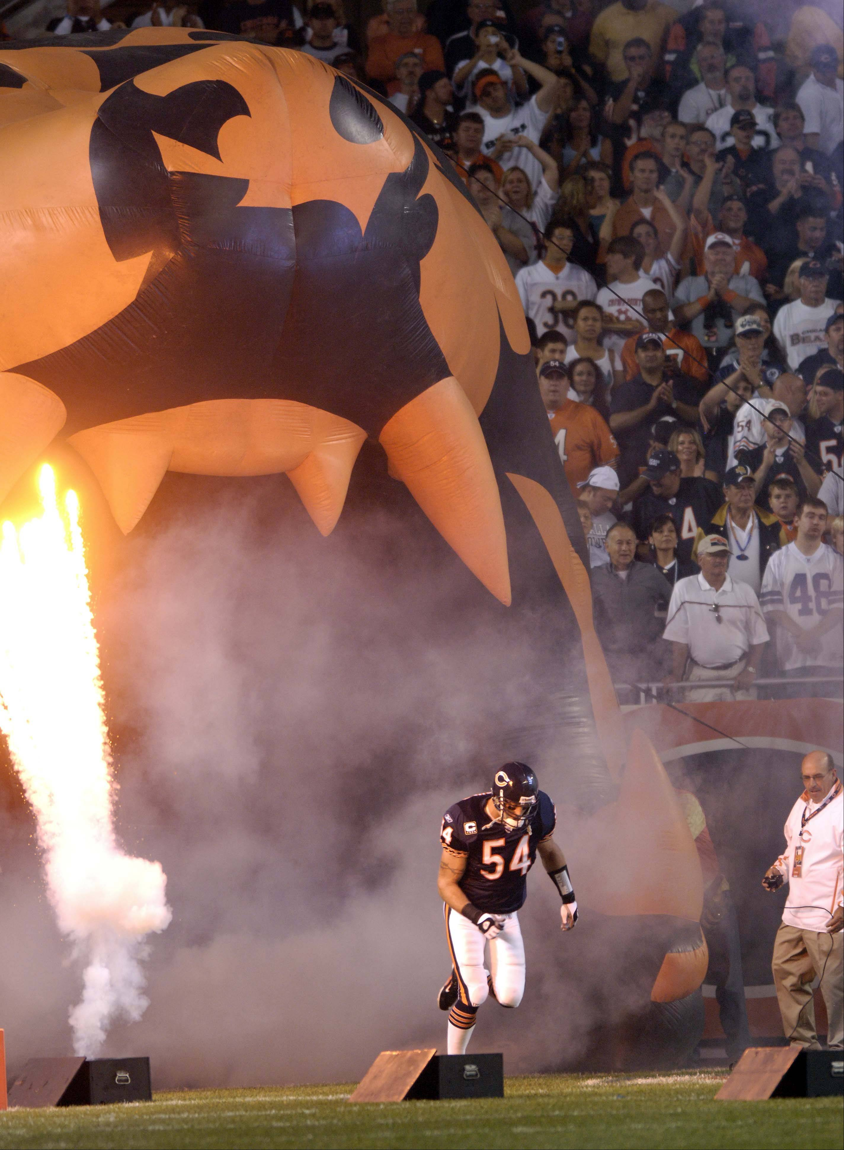 Brian Urlacher enters the field to play the Cowboys at Soldier field in Chicago.