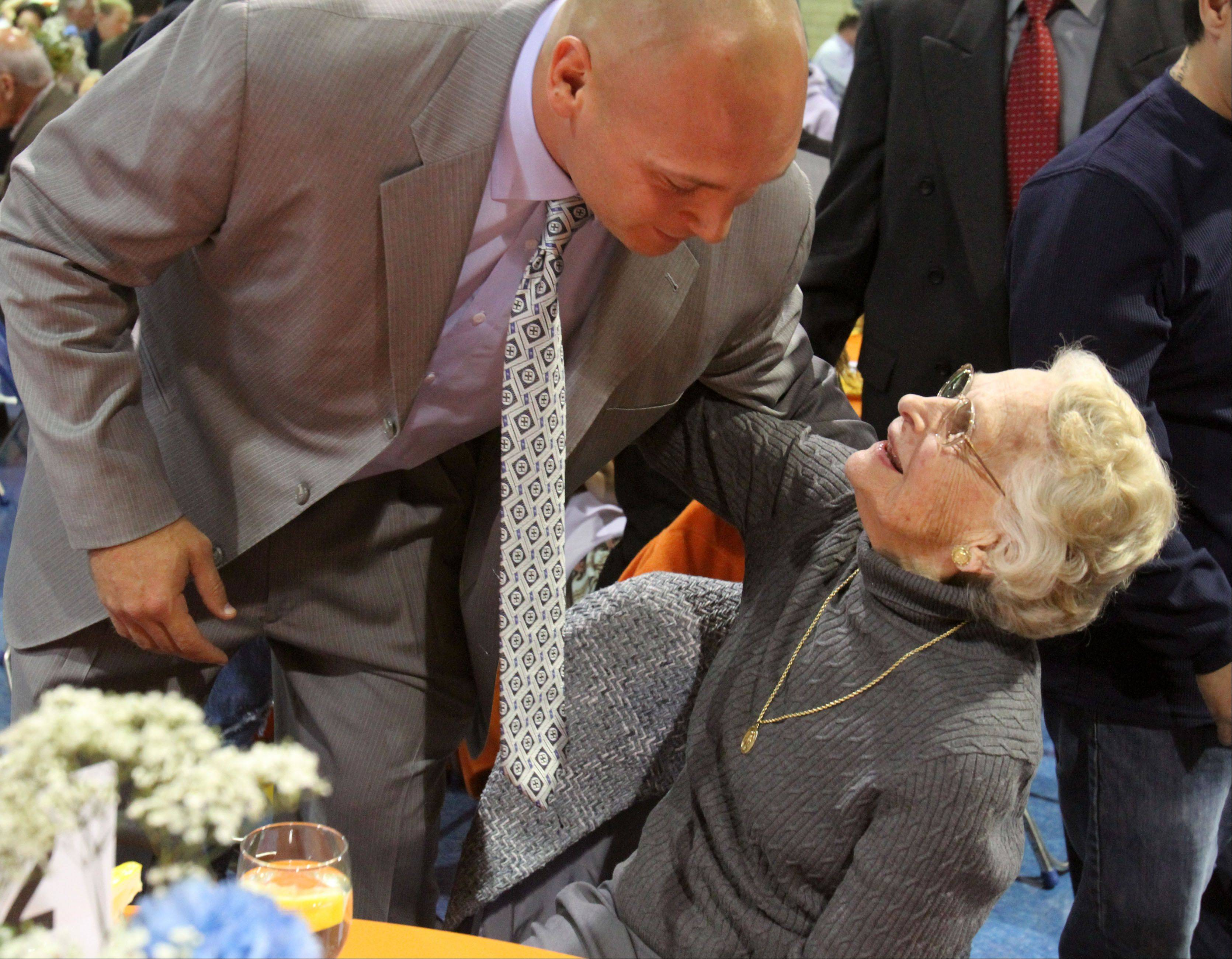 Brian Urlacher receives a hug from Virginia Halas McCaskey, principal owner of the Chicago Bears, before Urlacher received the Ed Block Courage Award at the Ed McCaskey Scholarship luncheon at Maryville Academy in Des Plaines.