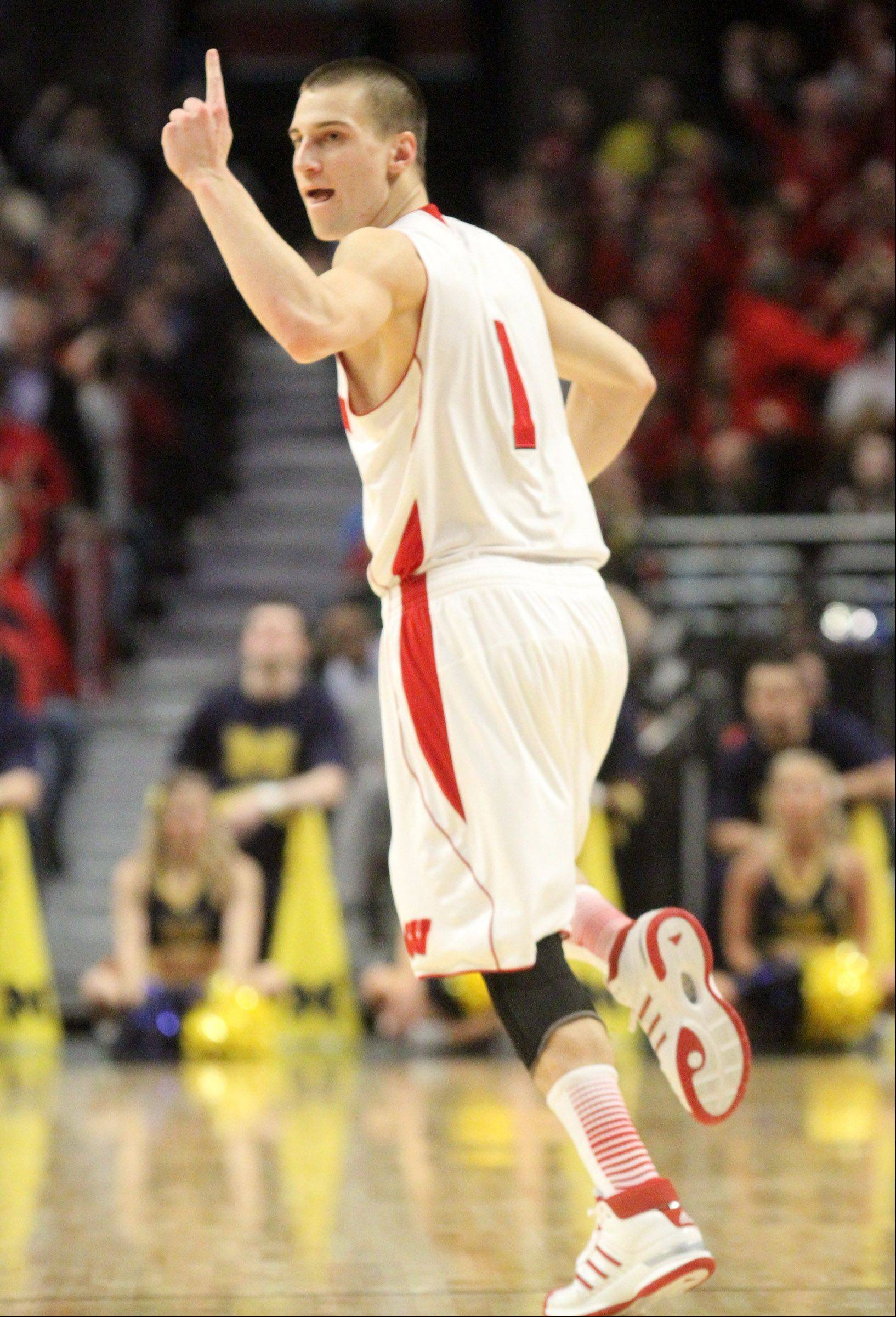Guard Ben Brust, here celebrating another 3-point basket, is one of the top scorers and rebounders for a balanced Wisconsin team. The Mundelein grad from Hawthorn Woods averages more than 13 points per game for the Badgers.