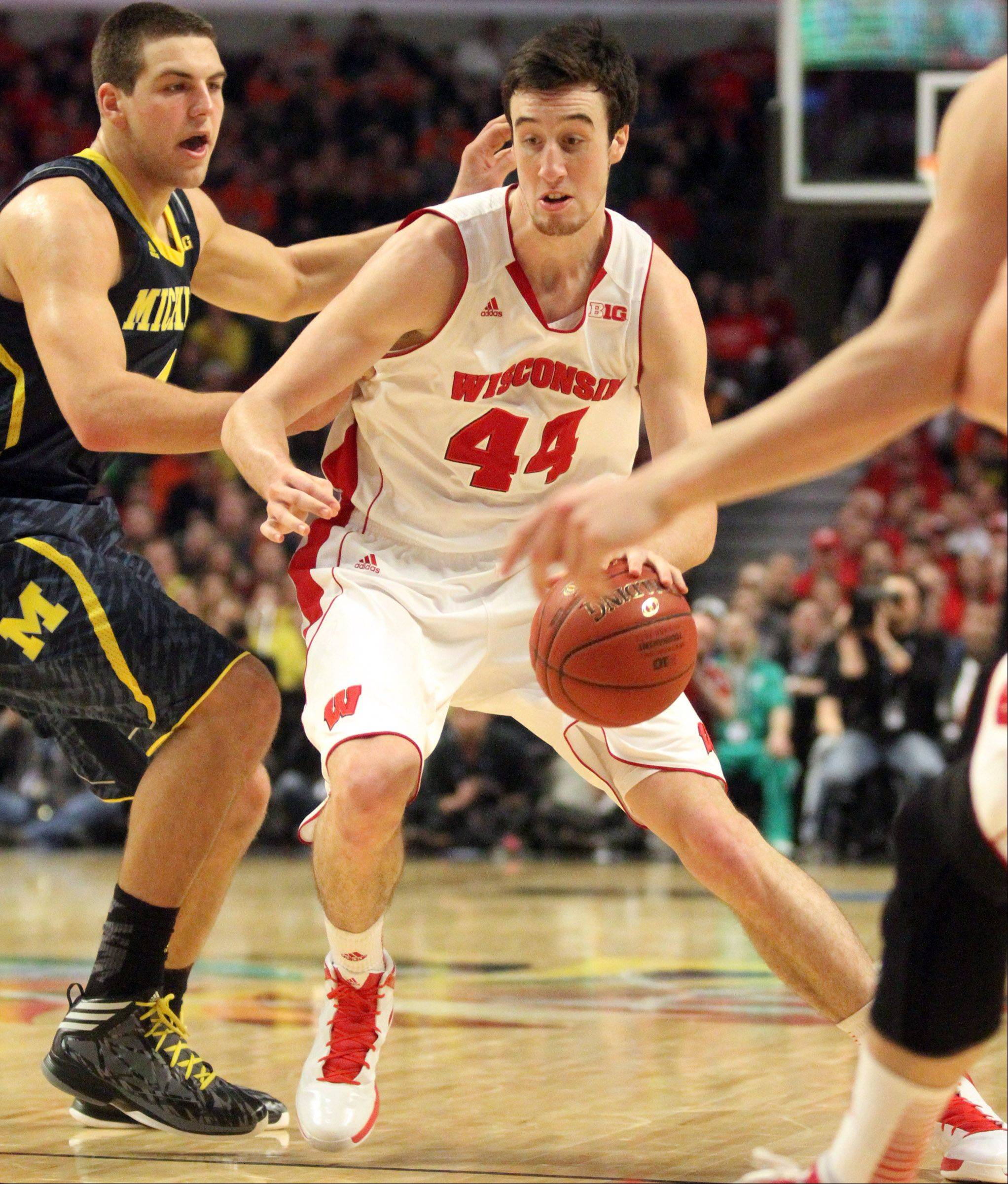 Wisconsin 6-11 forward Frank Kaminsky, who played at Benet Academy in Lisle, has been a key contributor to the team's success this season.