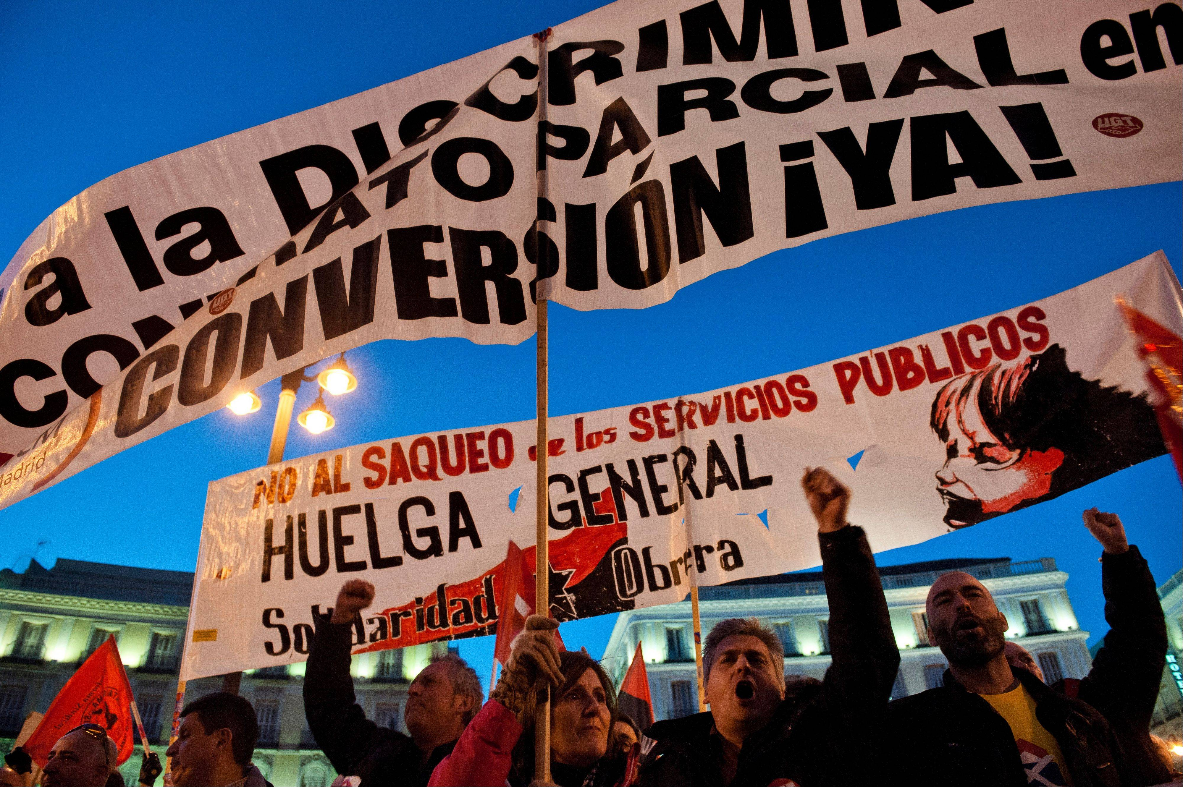 Workers from public transport unions demonstrate during a partial strike protest in Madrid, Wednesday.