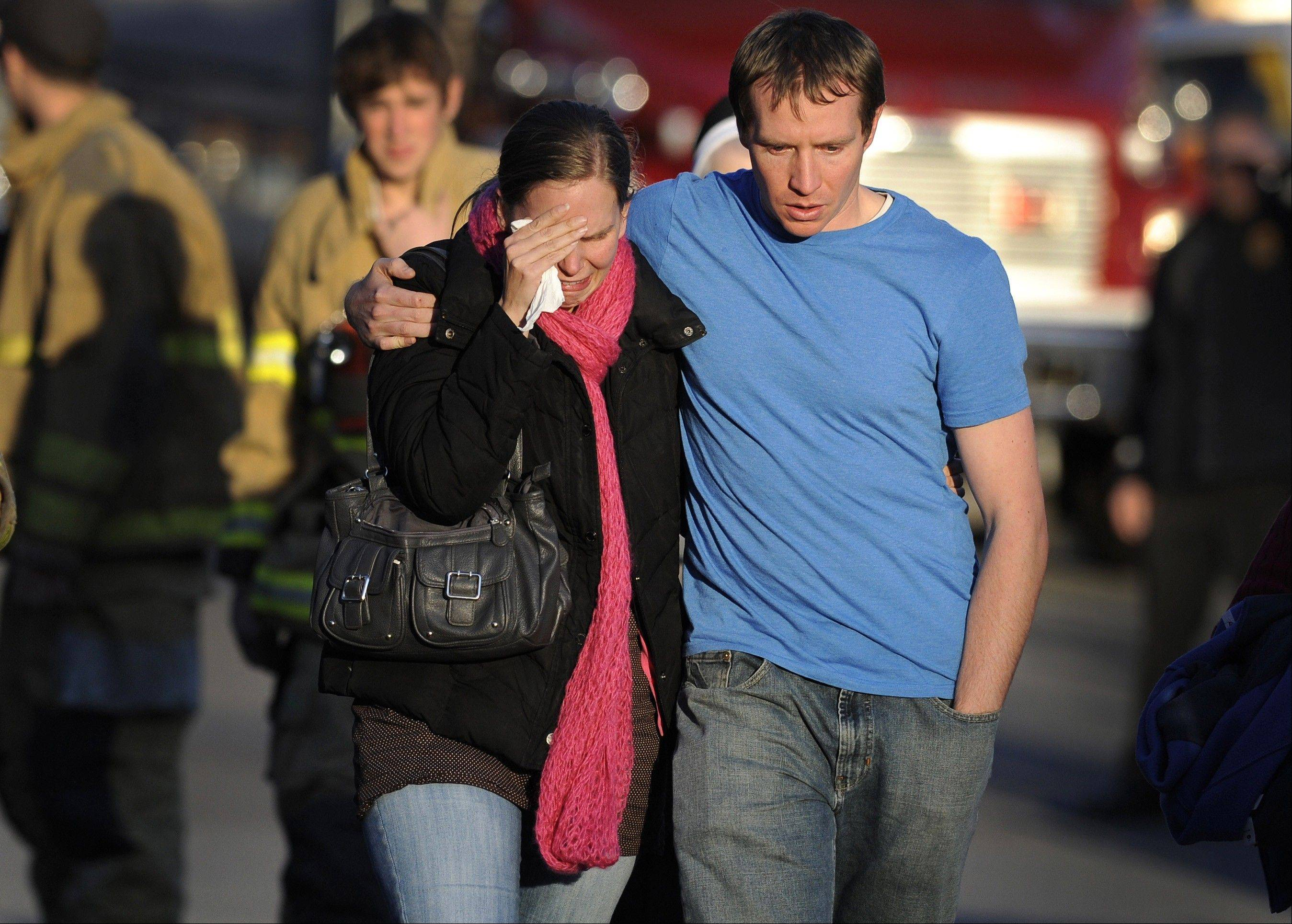 "Alissa Parker, left, and her husband, Robbie Parker, leave the firehouse staging after receiving word that their six-year-old daughter Emilie was one of the 20 children killed in the Sandy Hook School shooting in Newtown, Conn. Alissa Parker told ìCBS This Morningî in an interview that aired Thursday, March 21, 2013, that she wanted to meet with Adam Lanza's father, Peter Lanza, to tell him ""something"" she needed to get out of her system."