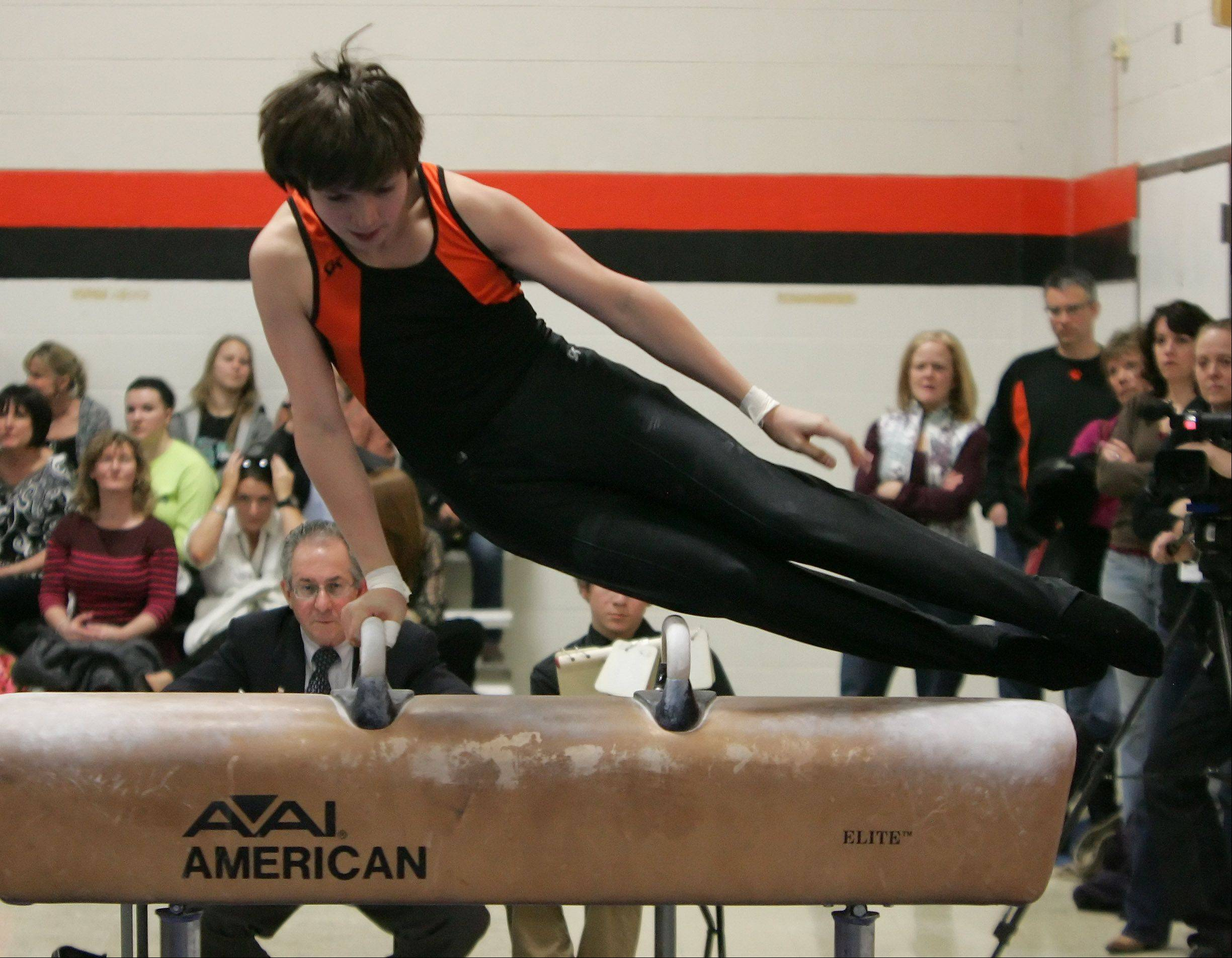 Libertyville gymnast Mark Pickar competes on the pommel horse during Thursday's meet against visiting Glenbrook North.