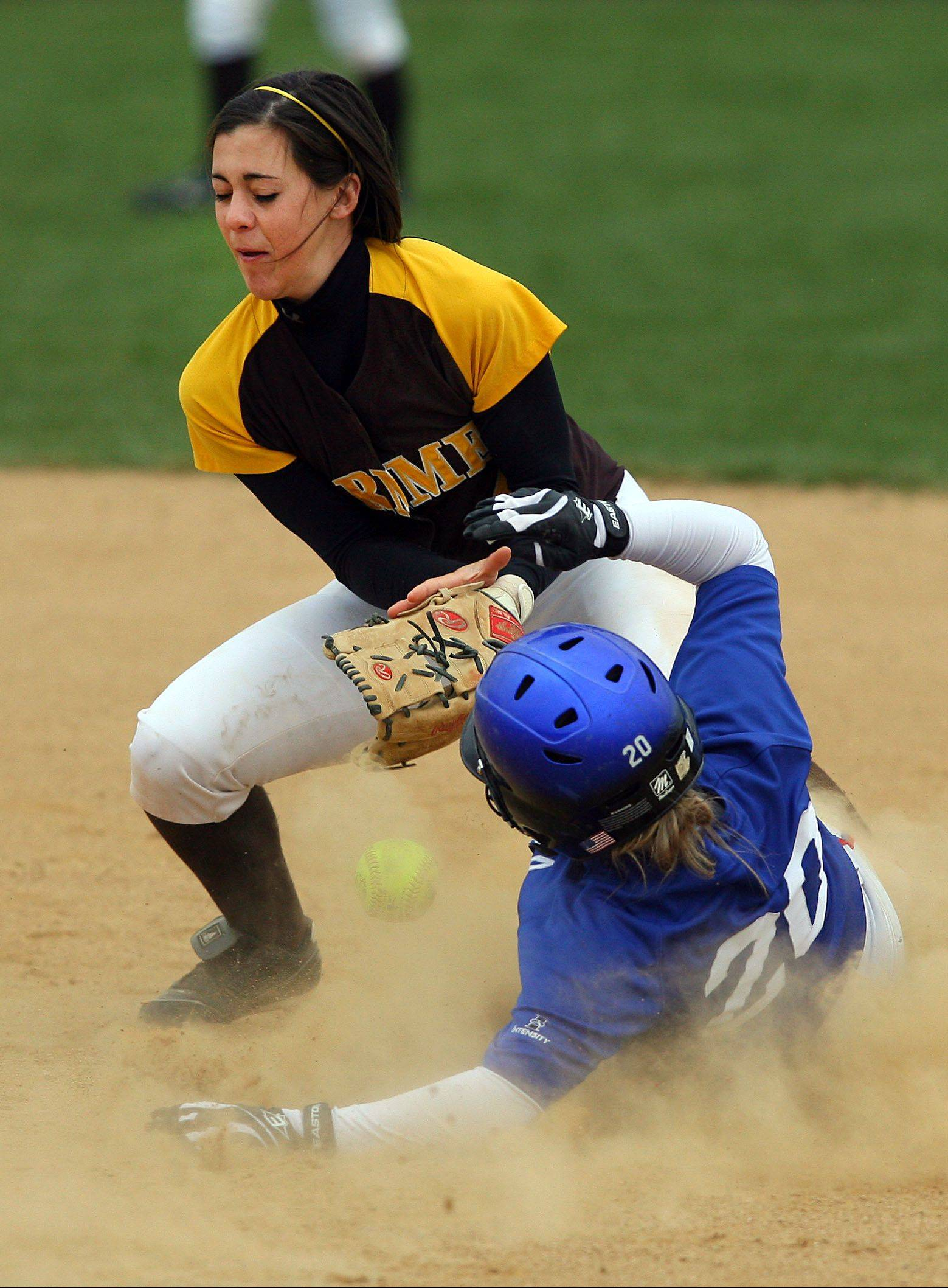 Carmel's Kathleen Felicelli tries to make the play as Lakes' Megan Milewski slides into second base last season in Mundelein.