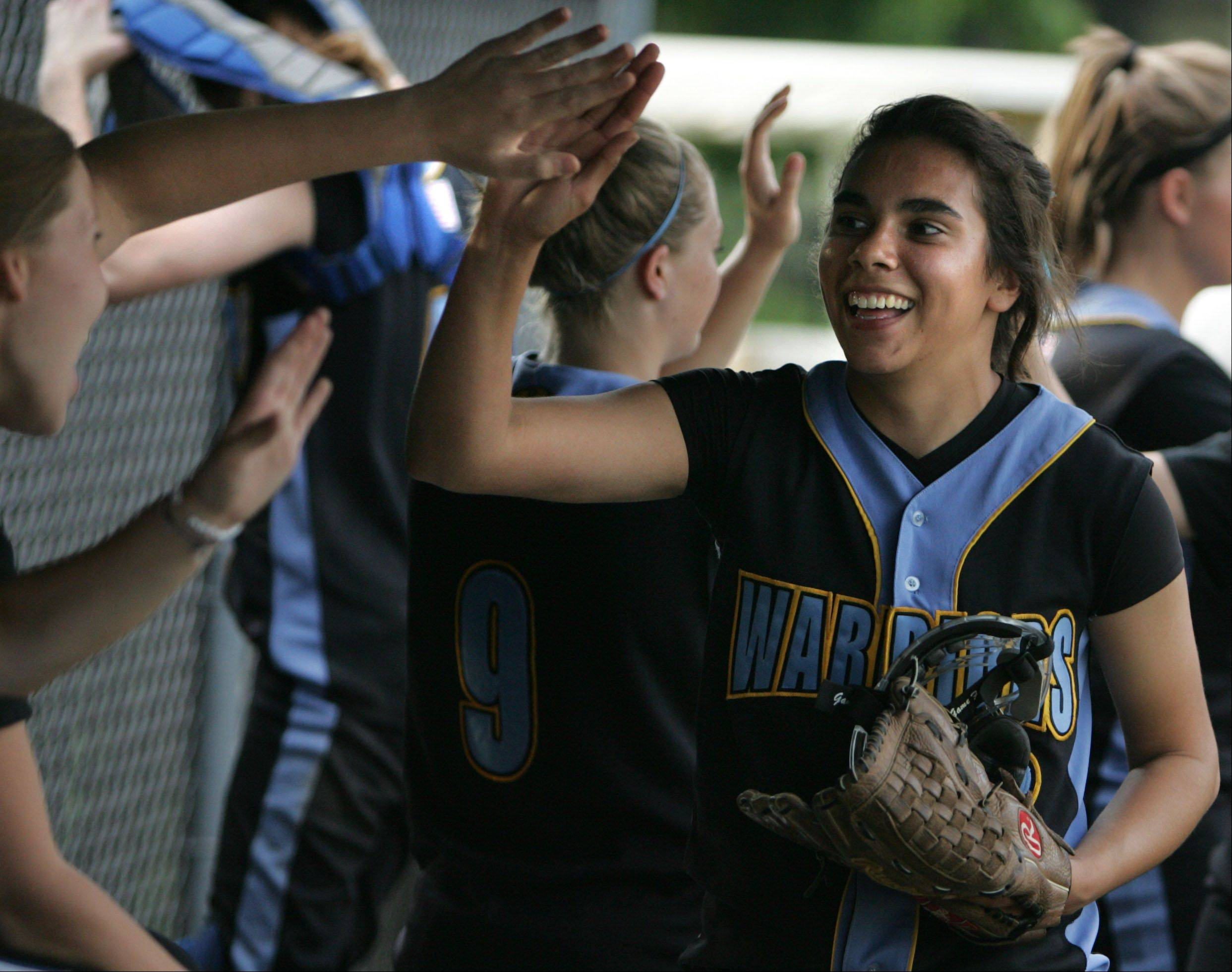 Maine West pitcher Ariel Valles is all smiles as she enters the dugout after pitching the sixth inning against Lane Tech in last season's regionals.