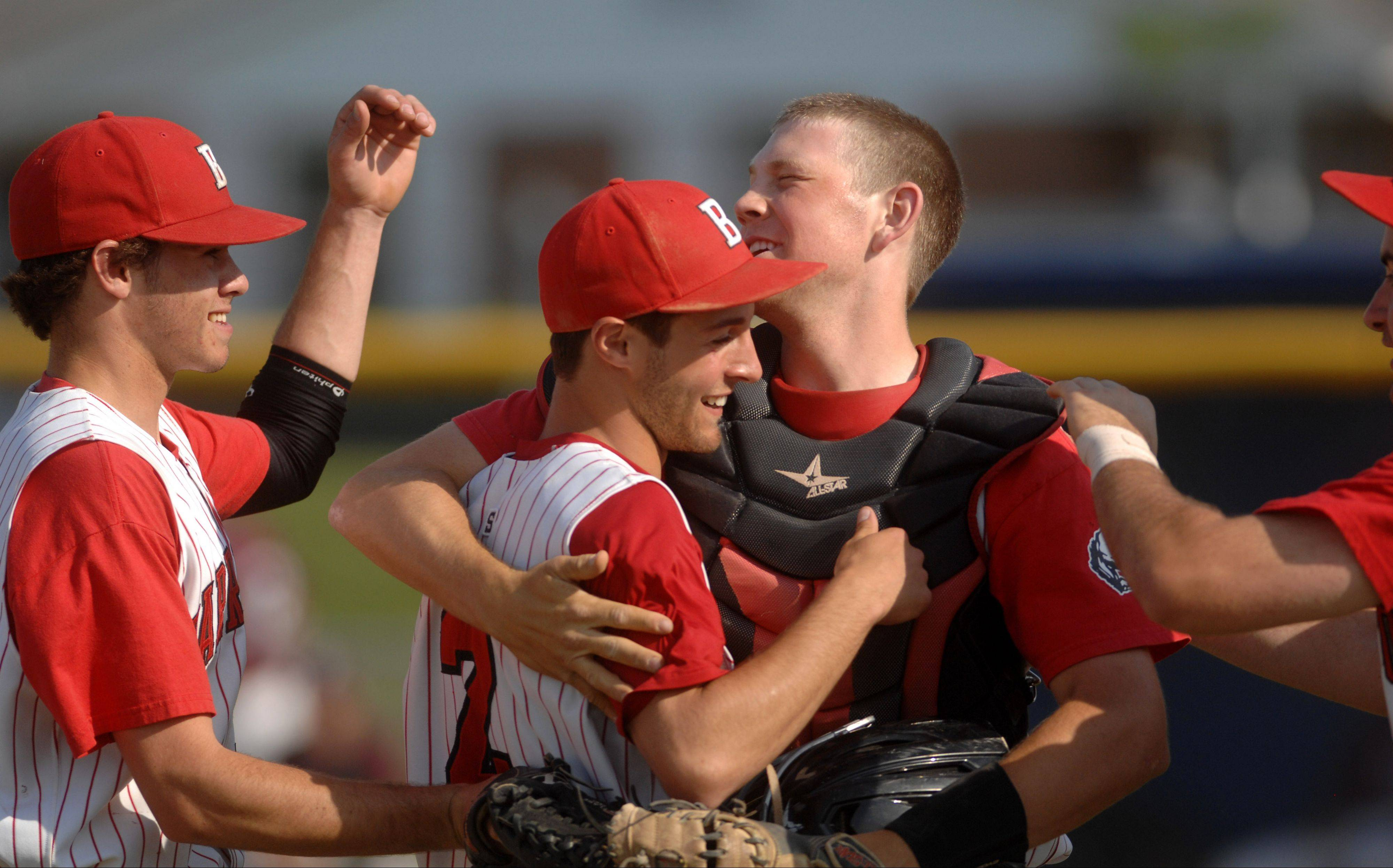Barrington catcher Ryan Lidge hugs teammate Chris Coco after a well-executed rundown led to a putout at the plate during the regional semifinals at Larkin last May.