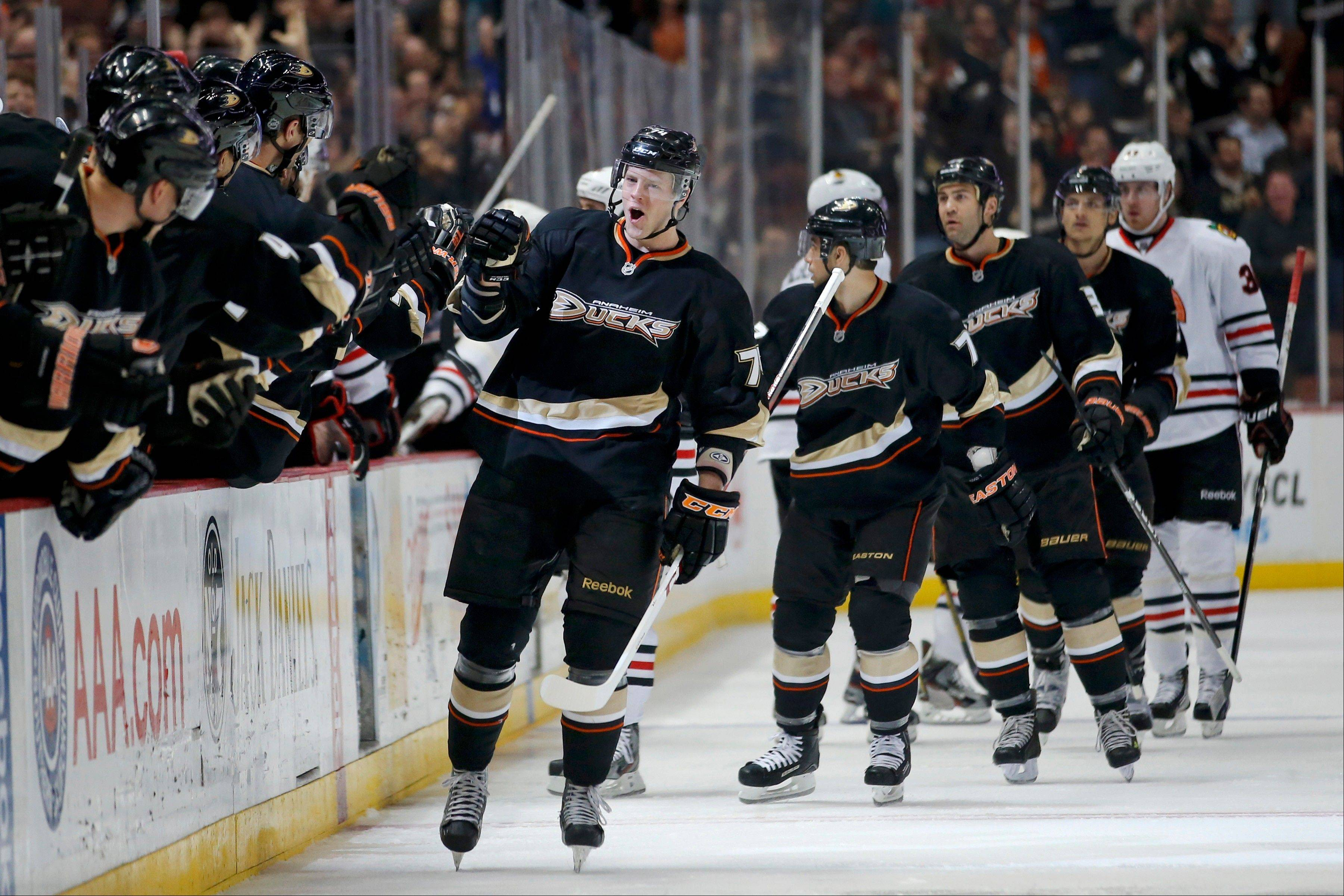 Anaheim Ducks' Peter Holland, center, celebrates his goal against the Chicago Blackhawks during the first period.