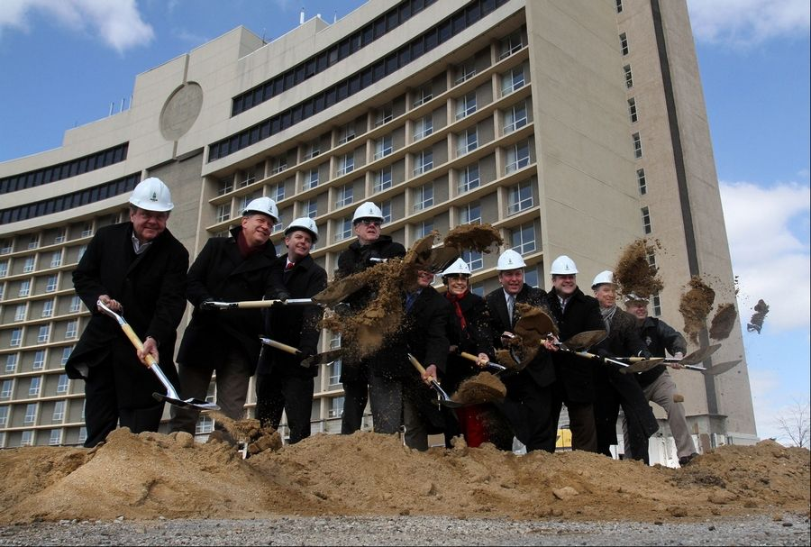 Arlington Heights Mayor Arlene Mulder and David Trandel, partner in the project, sixth and seventh from left, participate in the groundbreaking Wednesday for a $250 million apartment, retail and commercial project known as Arlington Downs on Euclid Avenue just west of Arlington Park.