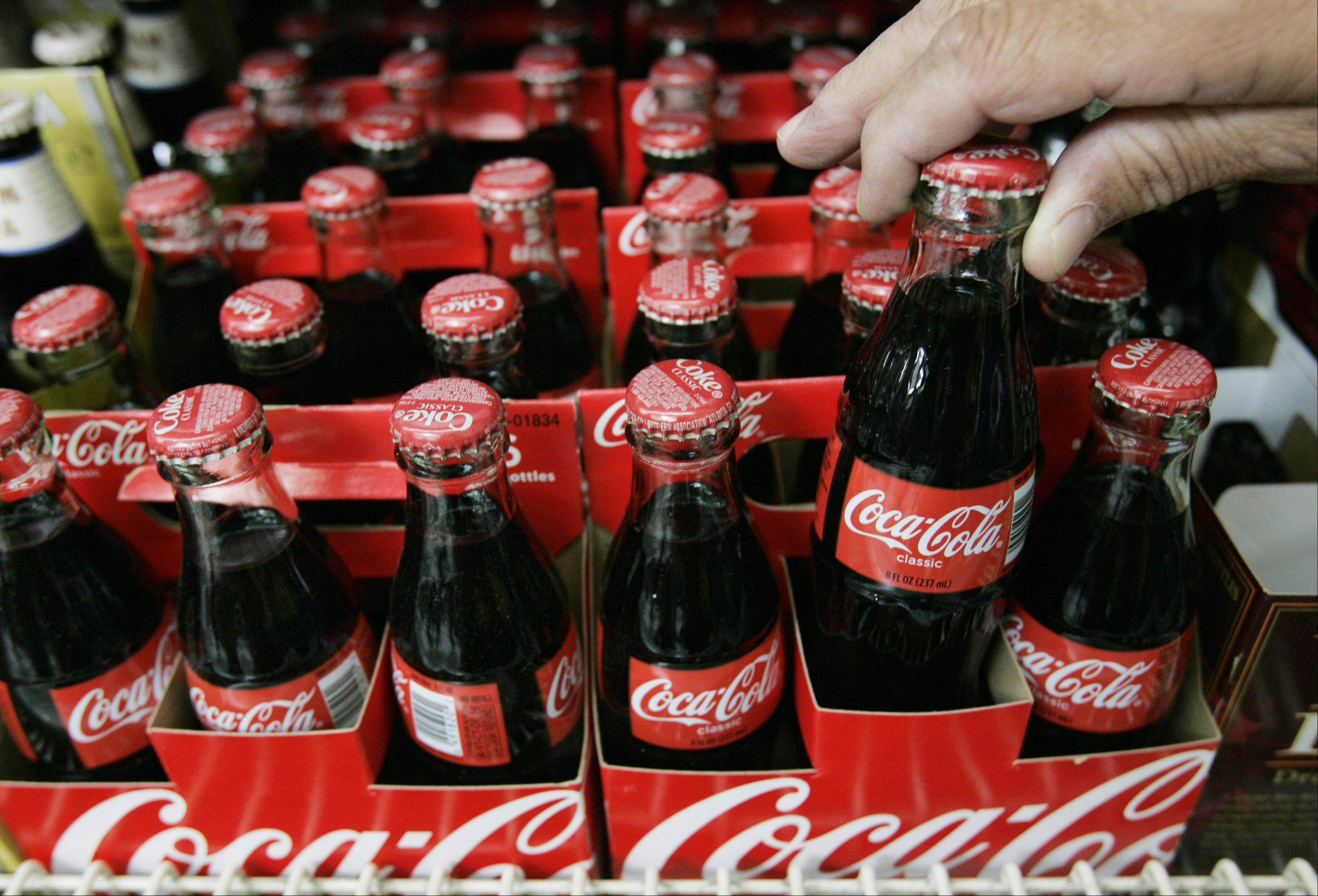 Coca-Cola says it's cutting 750 jobs in the U.S. as it continues to streamline its business.