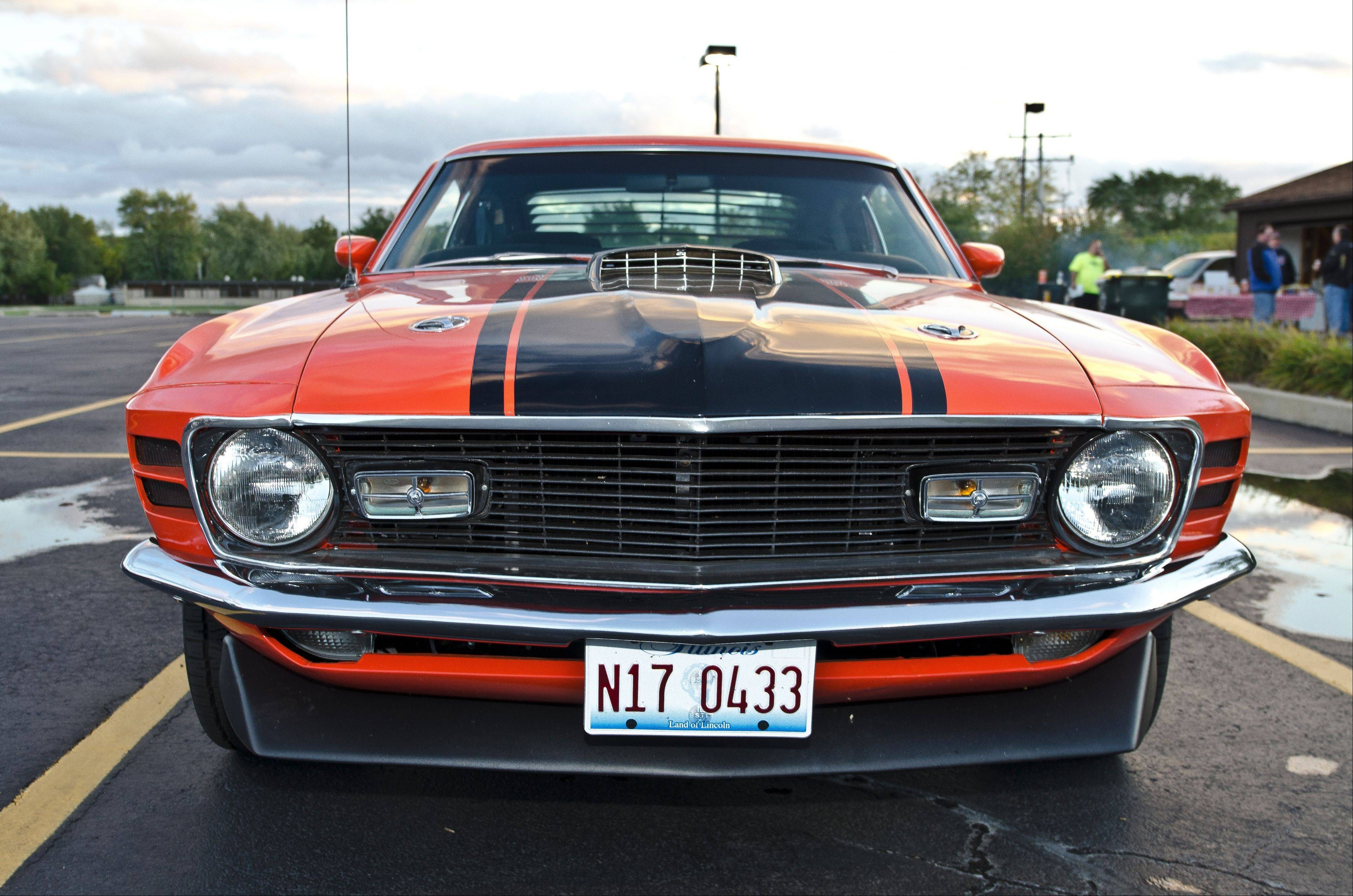 Otto's Mustang is now covered in a Calypso Coral paint color with black stripes.