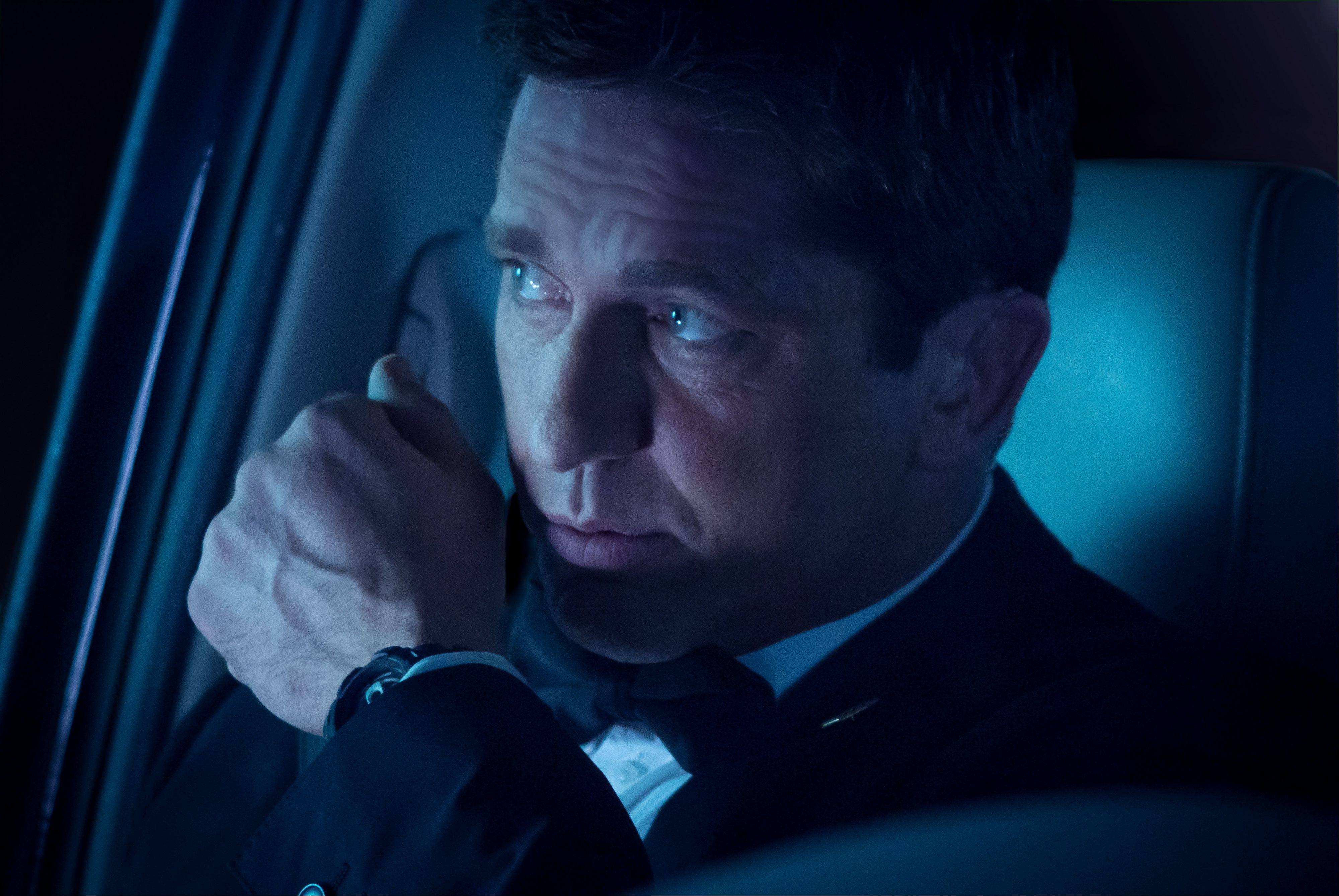 "Secret Service Agent Mike Banning (Gerard Butler) goes Die Hard on North Korean terrorists in Antoine Fuqua's action yarn ""Olympus Has Fallen."""