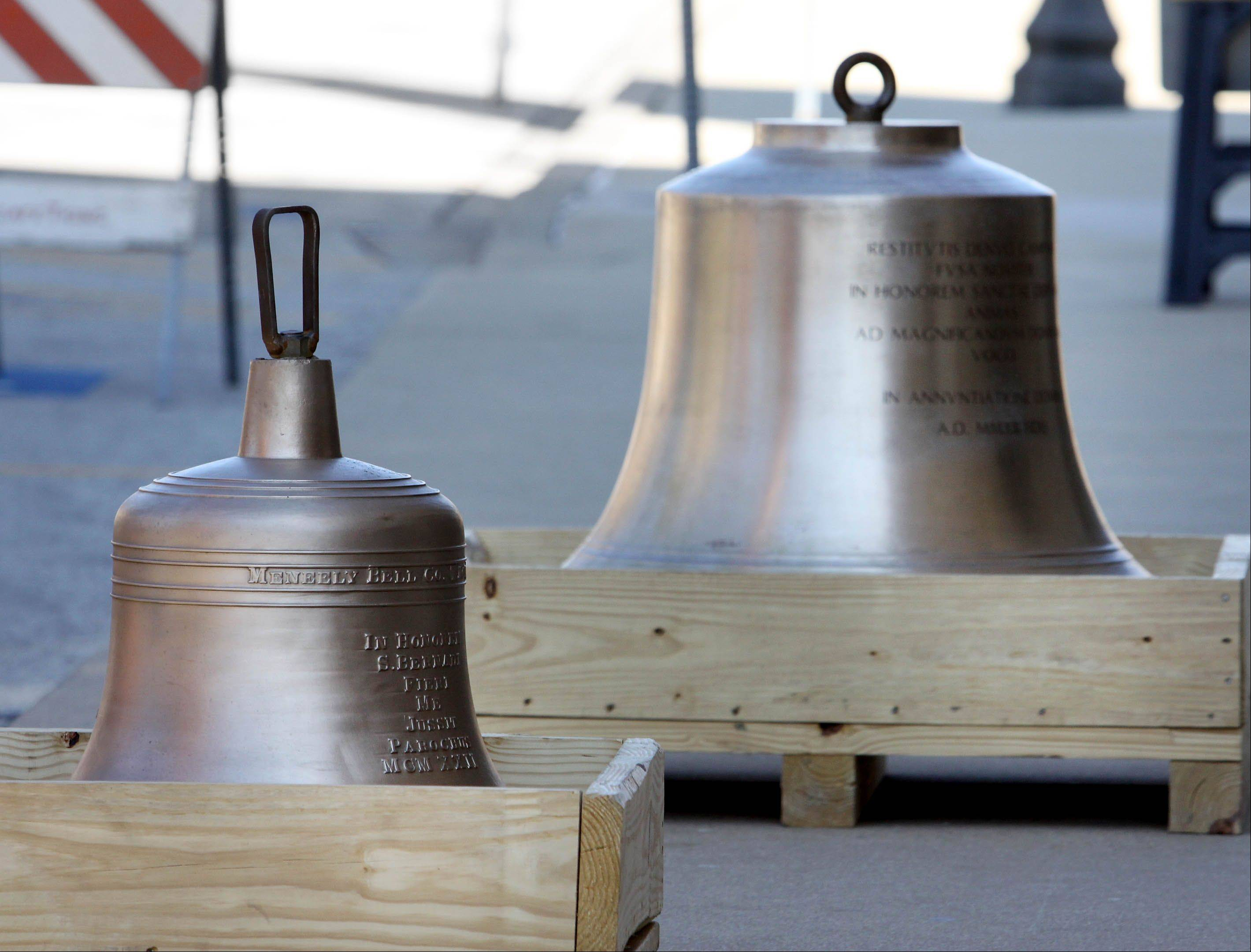 Newly cast and refurbished church bells were hoisted Thursday into the bell tower at Ss. Peter and Paul Catholic Church in Naperville.