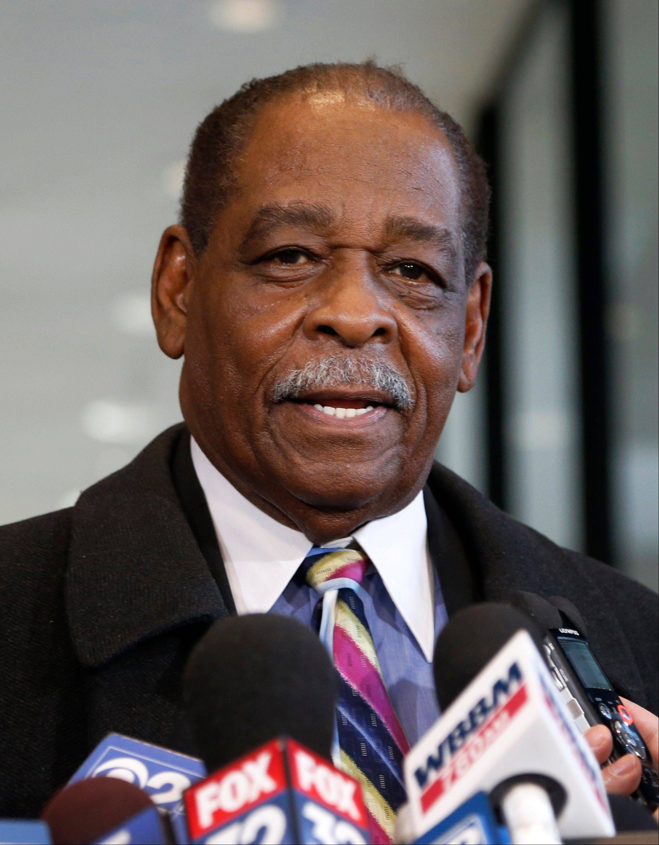 Cook County Commissioner William Beavers talks to reporters Thursday in Chicago after he was convicted of tax evasion for not declaring campaign cash he gambled away on slot machines as income.