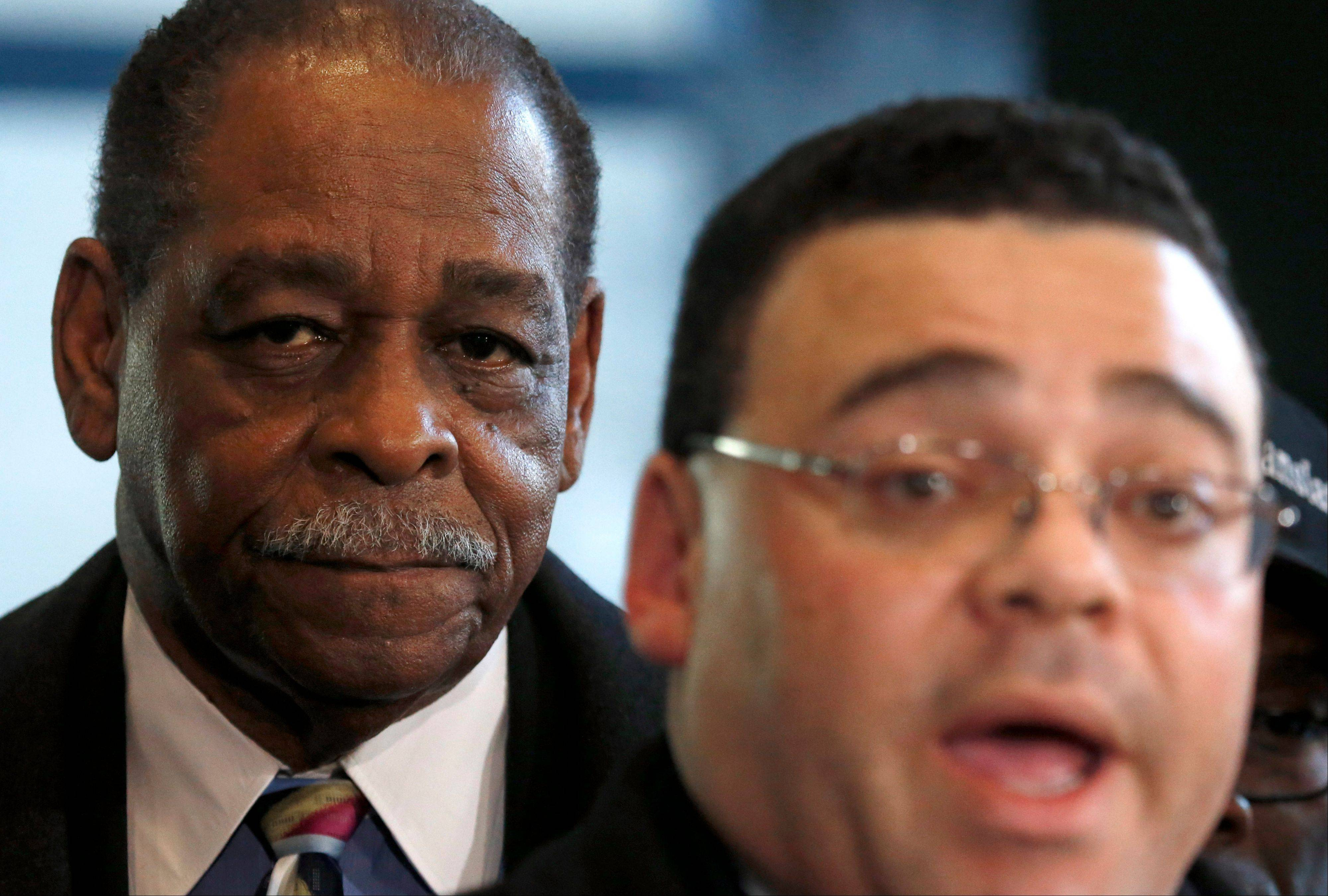 Cook County Commissioner William Beavers, left, listens to his attorney Sam Adam Jr. as they meet with reporters Thursday outside the federal building in Chicago. Beavers has vowed to appeal his conviction.