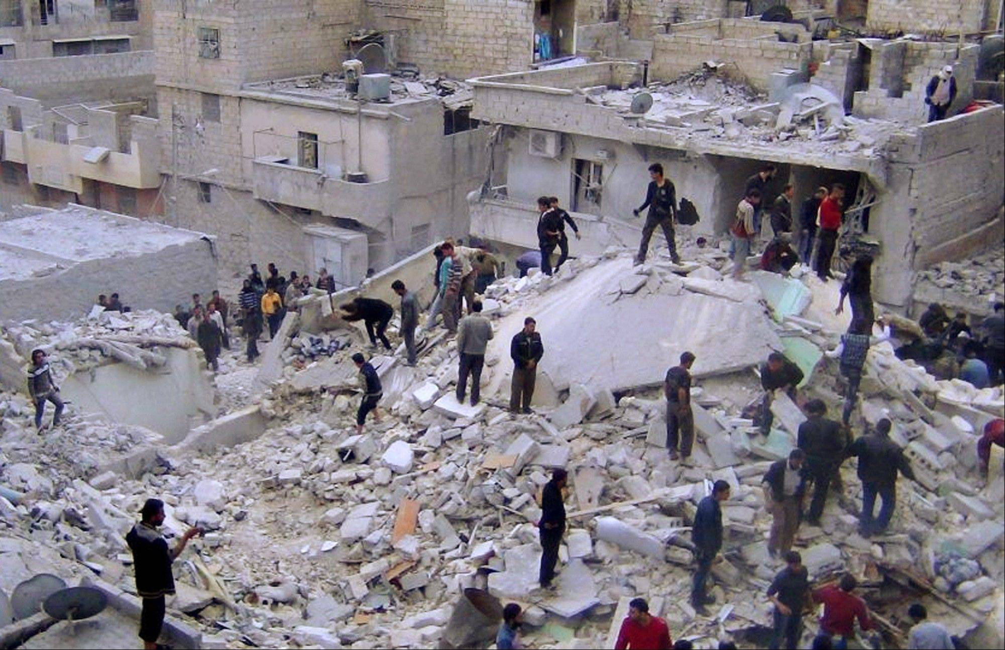 In this citizen journalism image taken on Wednesday, Syrian citizens search for dead bodies on the rubble of damaged buildings that were attacked by Syrian forces airstrikes in Aleppo. Syrian rebels captured one village and parts of others on the edge of the Golan Heights Thursday as fighting closed in on the strategic plateau that Israel captured from Syria in 1967 and later annexed, activists and officials said.