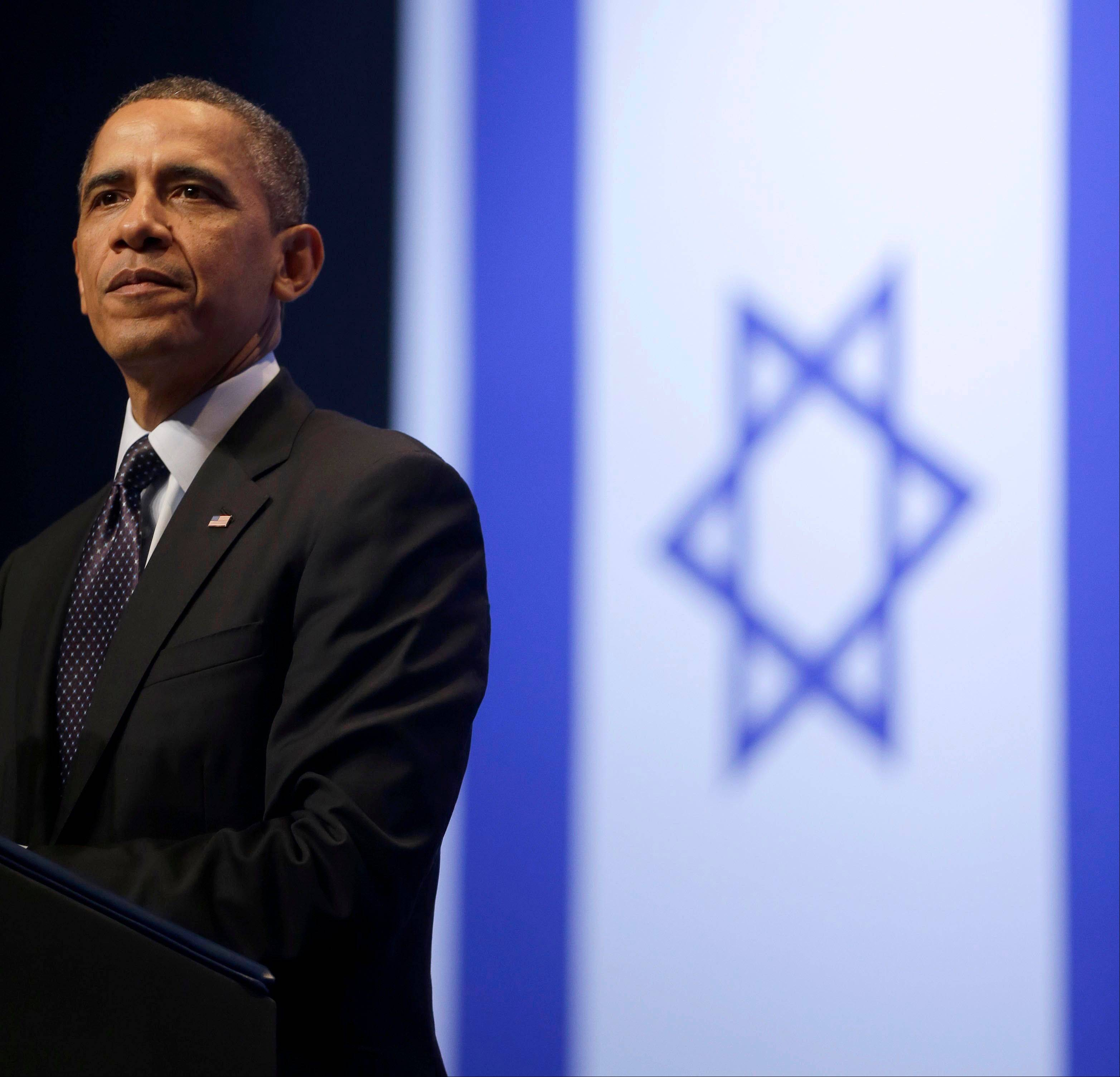 "President Barack Obama pauses during his speech at the Jerusalem Convention Center in Jerusalem, Israel, Thursday, March 21, 2013. ""The Palestinian people's right to self-determination and justice must ... be recognized,"" he said. ""Put yourself in their shoes -- look at the world through their eyes. It is not fair that a Palestinian child cannot grow up in a state of her own, and lives with the presence of a foreign army that controls the movements of her parents every single day."""