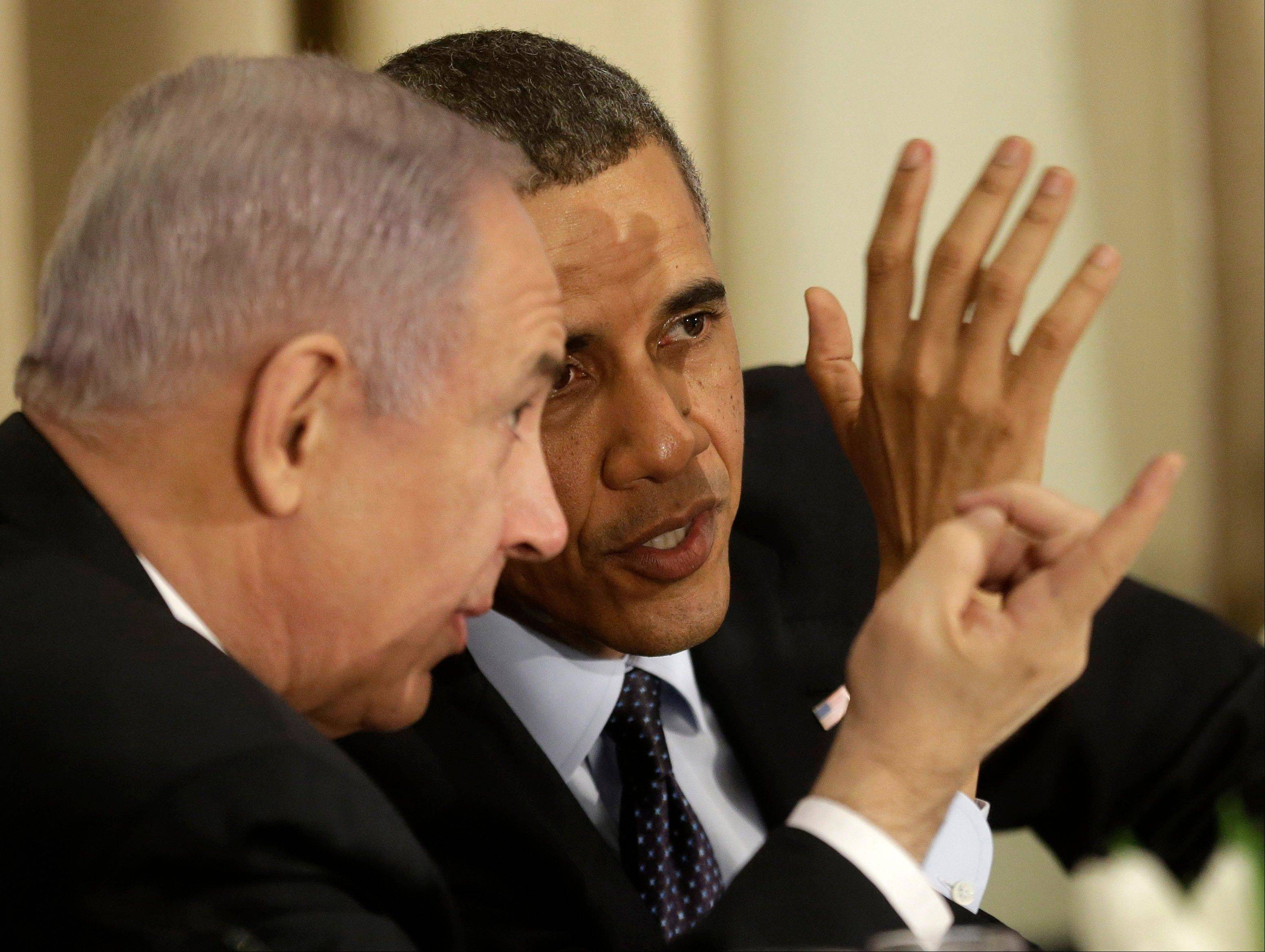 President Barack Obama talks with Israeli Prime Minister Benjamin Netanyahu during a state dinner in Jerusalem Thursday.