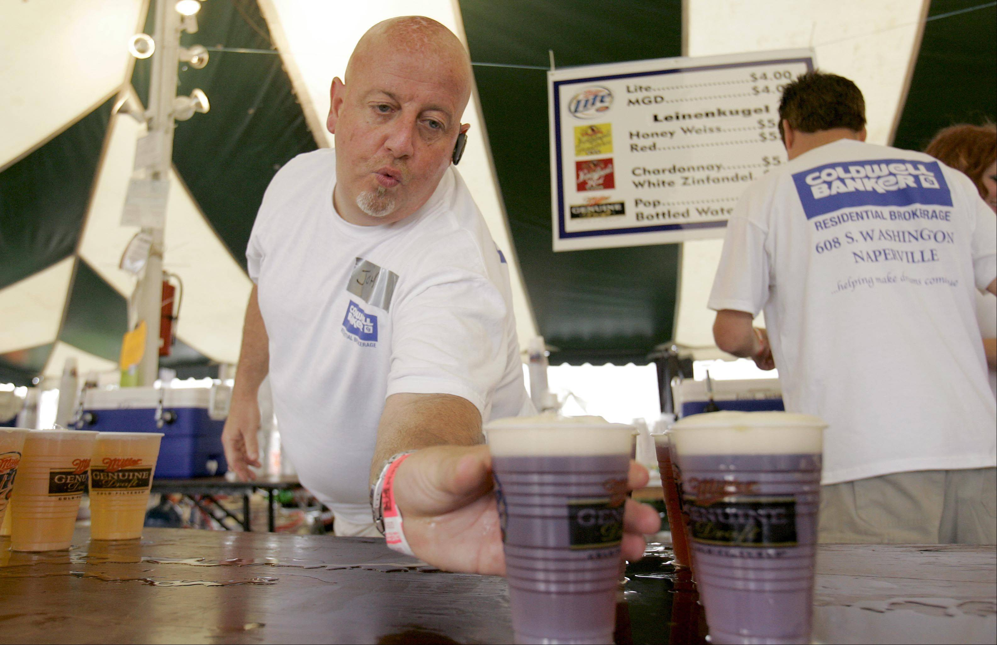Ribfest beer tent volunteers will have more time to serve cold brews this year since they will no longer be handling money and making change between pours.