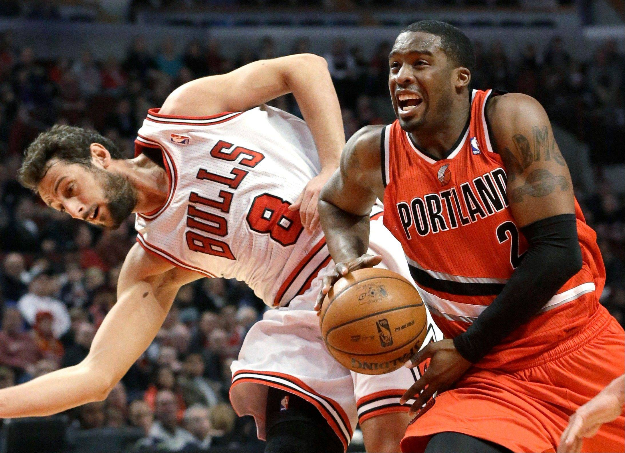 Trail Blazers guard Wesley Matthews leaves the Bulls' Marco Belinelli in his wake on a drive to the basket Thursday night at the United Center.
