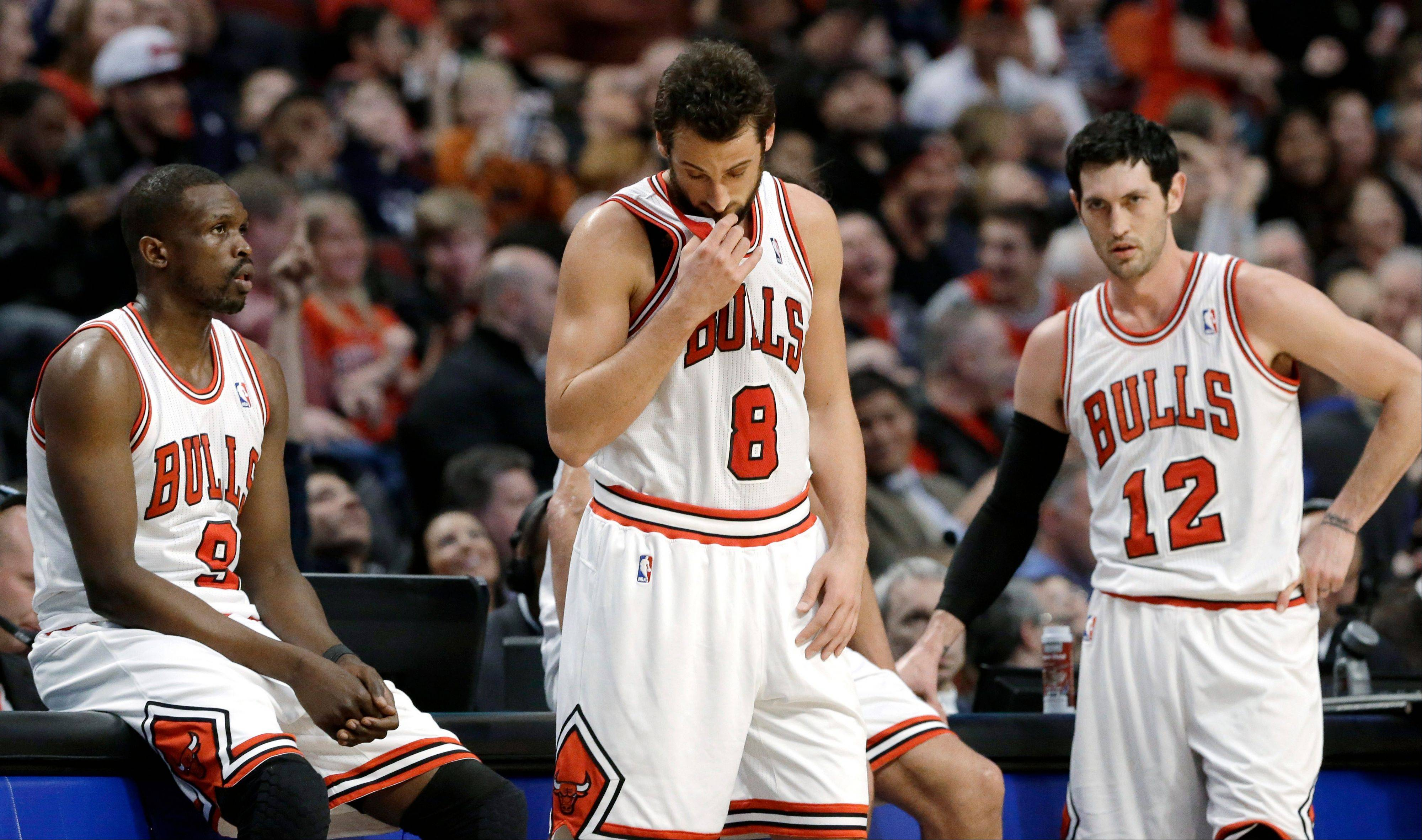 Chicago Bulls guard Marco Belinelli, center, forward Luol Deng, left, and guard Kirk Hinrich react during the second half of an NBA basketball game against the Portland Trail Blazers in Chicago on Thursday, March 21, 2013. The Trail Blazers won 99-89.