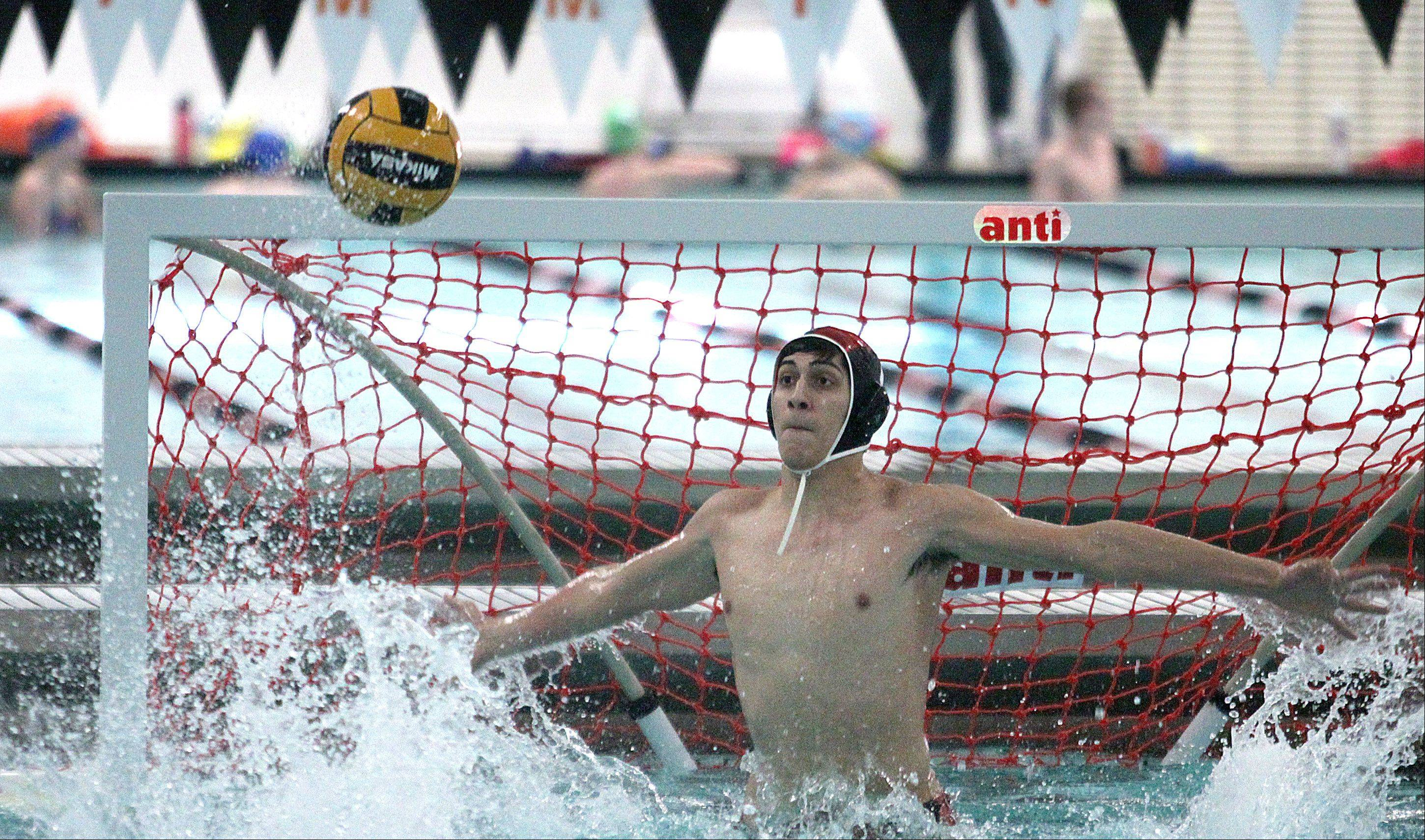 St Charles East's goalie Nick Fagen prepares to make a save during a varsity water polo game against St. Charles North at John Baker Norris Recreation Center on Thursday night.