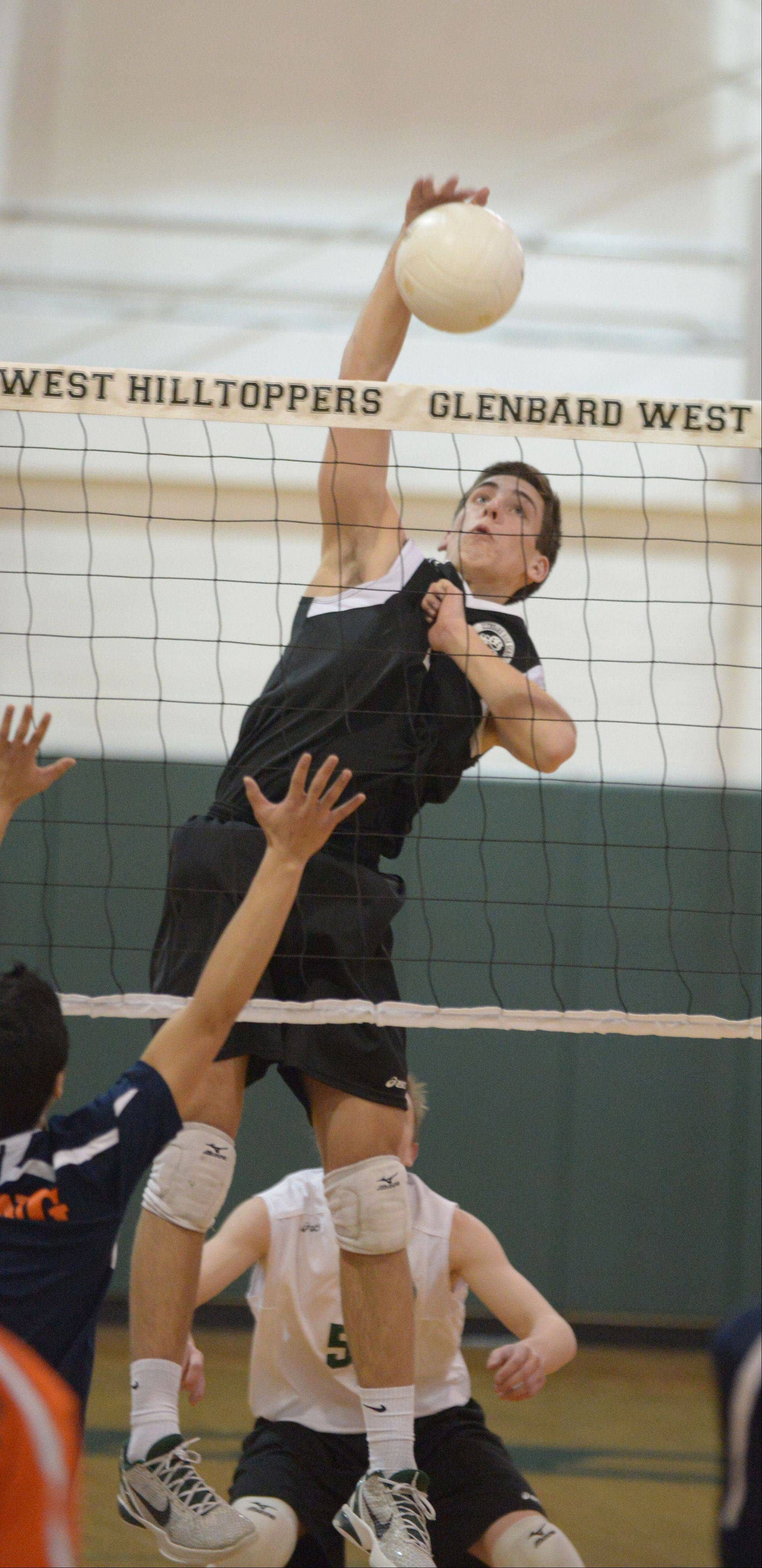 Sean Dedmond of Glenbard West goes up for a spike during the Whitney Young at Glenbard West boys volleyball game Thursday.