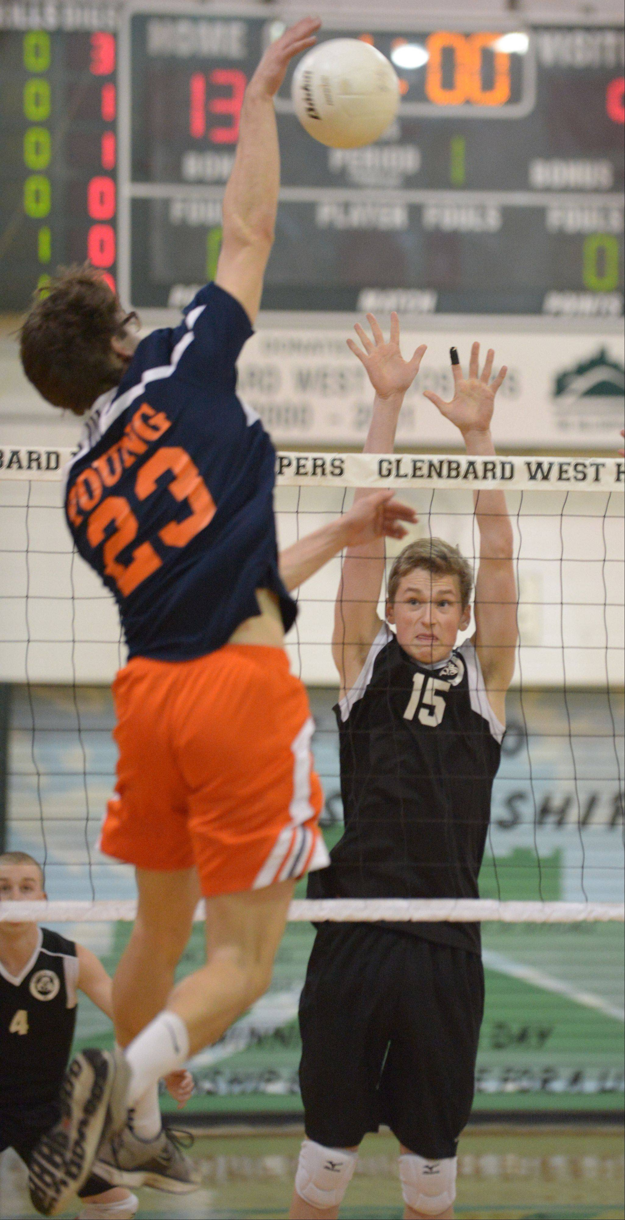 Jackson Nagle of Glenbard West gets ready to block a shot from Tom Wesolow of Whitney Young. This took place during the Whitney Young at Glenbard West boys volleyball game Thursday.
