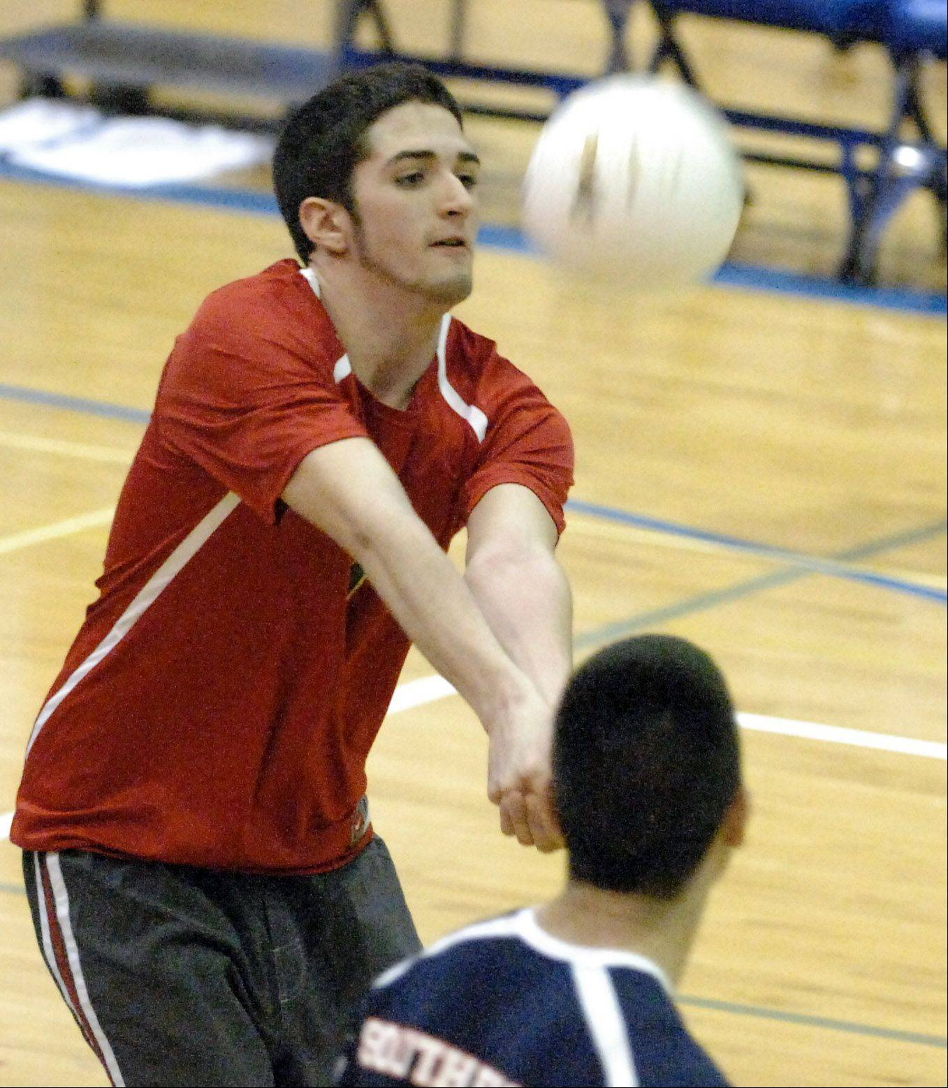 South Elgin's Joe Lullo returns a serve against Larkin during Thursday's game at Larkin in Elgin.