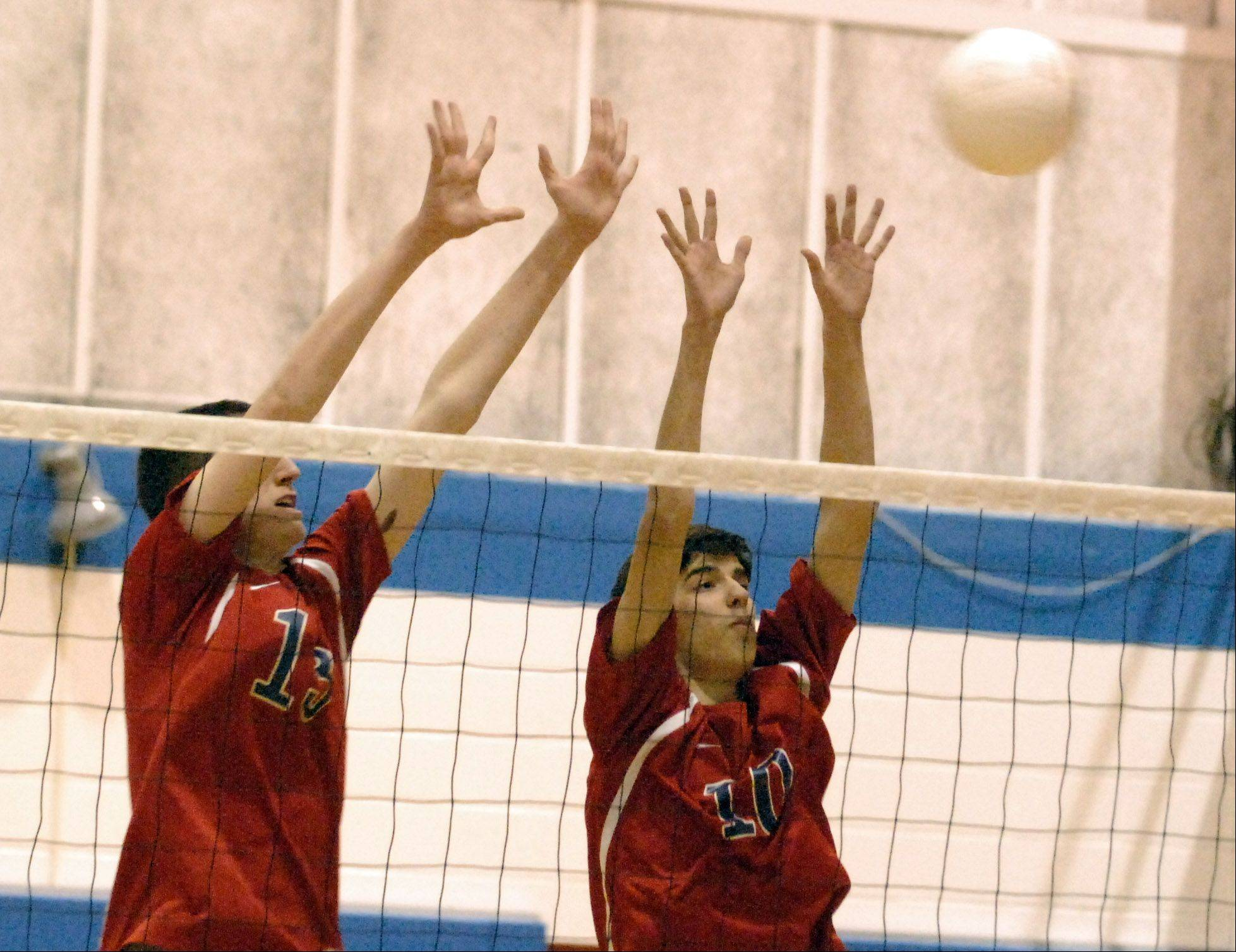 South Elgin's Ian Saxton, left, and Chris Gibadlo go up for a block against Larkin during Thursday's game at Larkin in Elgin.