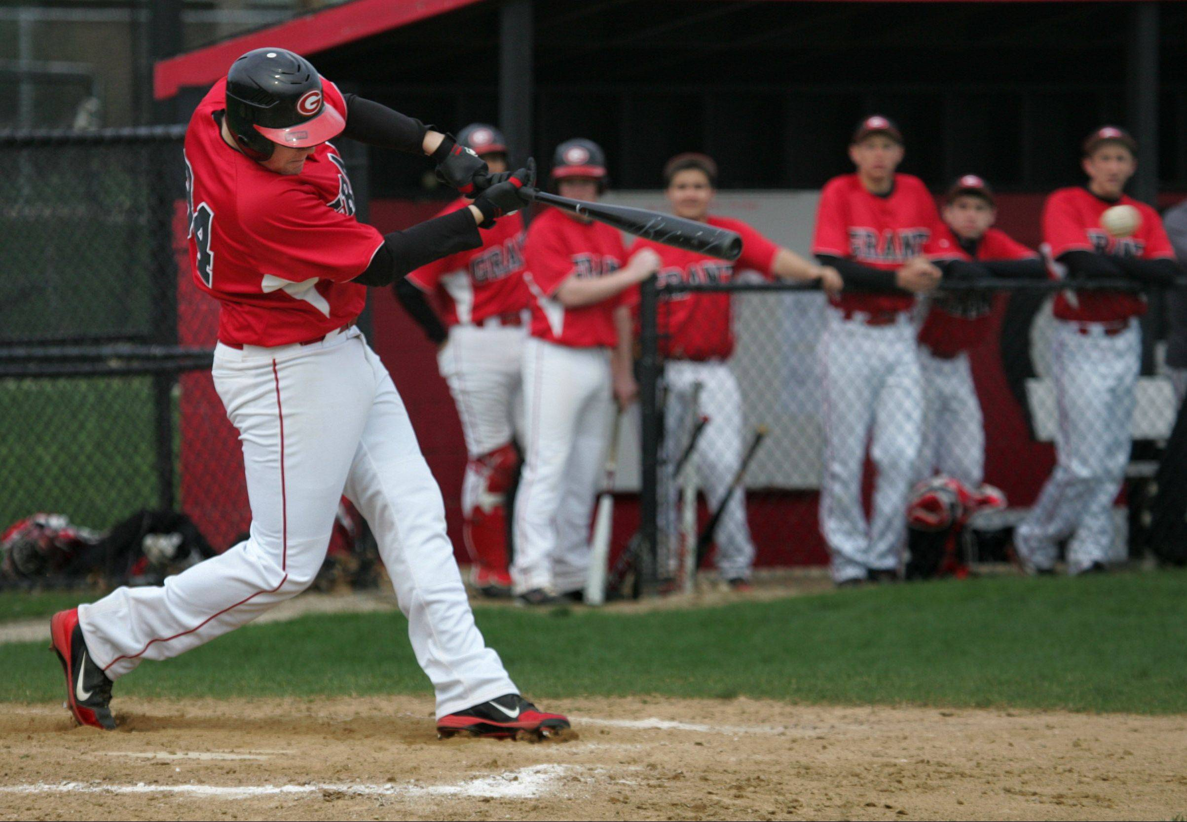Grant's Brent Spohr swings into action last season against visiting West Chicago.