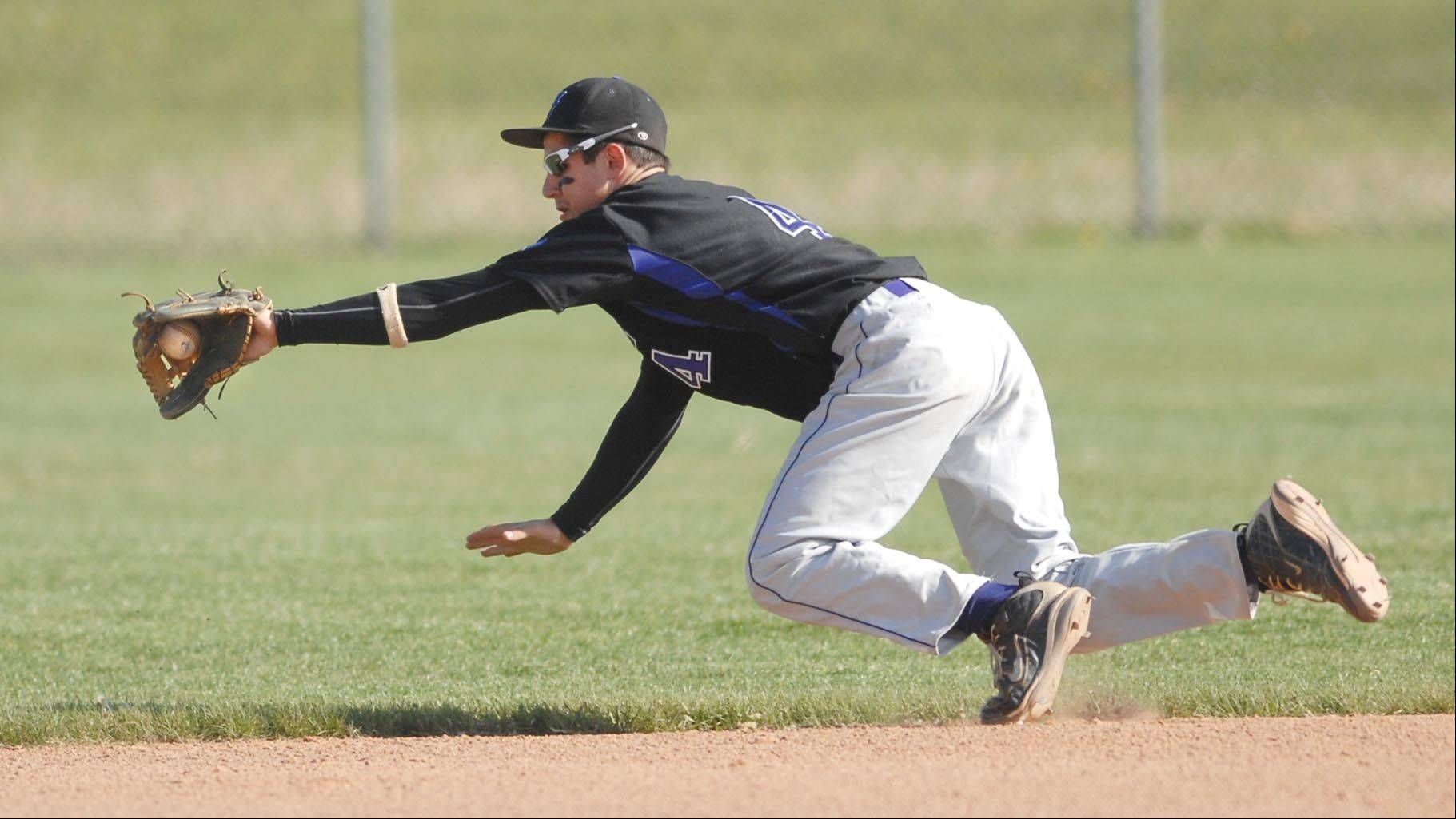 Hampshire shortstop Michael Laramie grabs a ground ball last season against Burlington Central.
