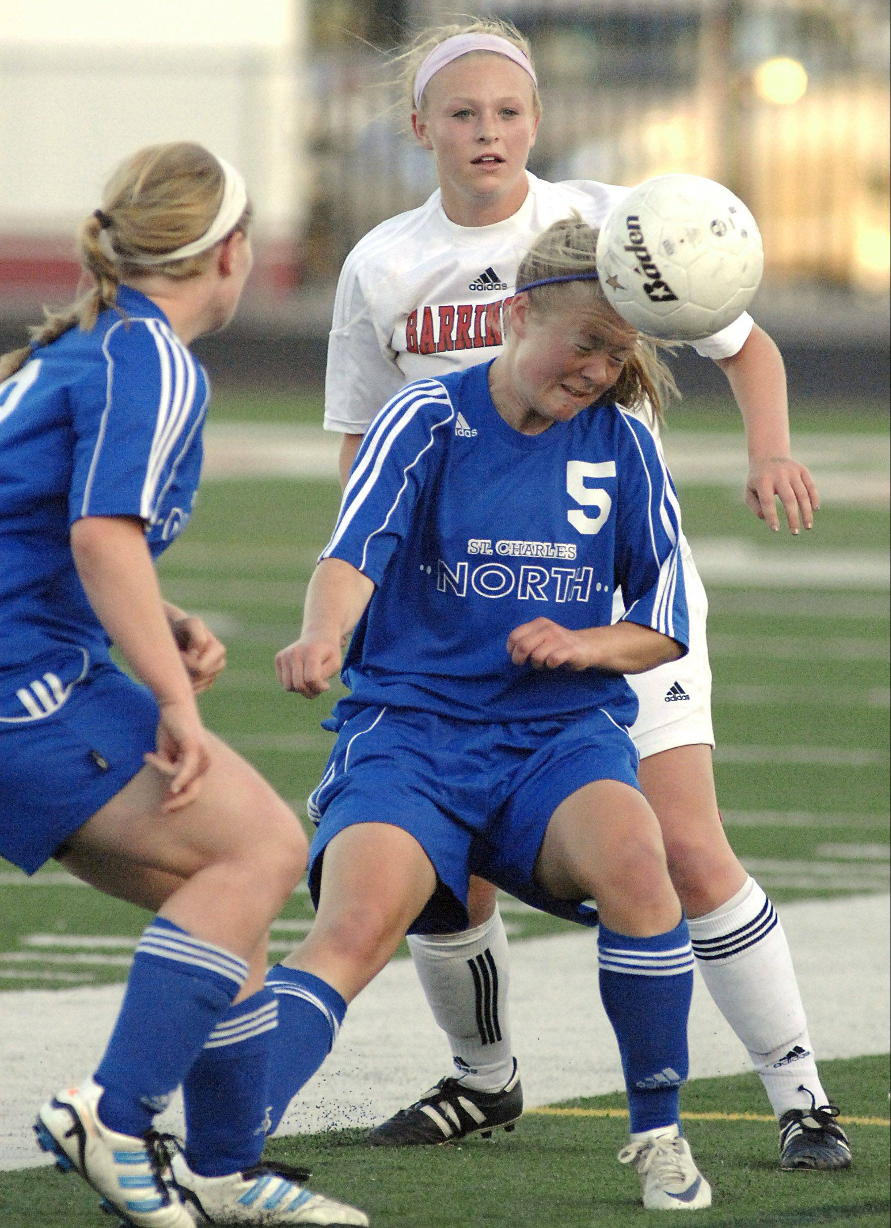Natalie Winkates heads a ball during St. Charles North's supersectional victory last year.