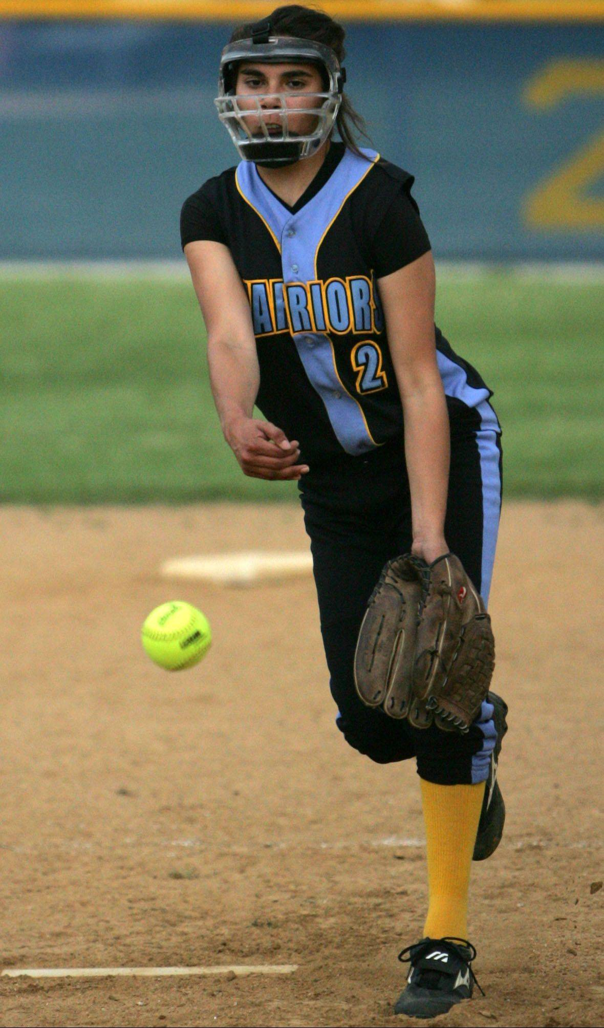 Maine West's Ariel Valles delivers against Lane Tech in last season's playoffs.