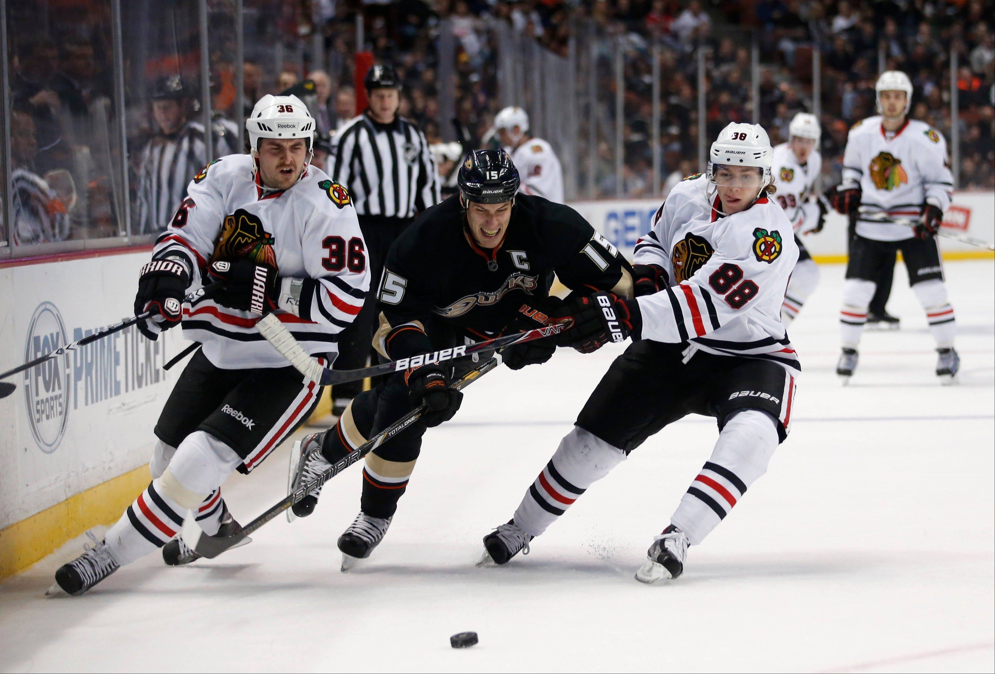 Patrick Kane, right, played more than 25 minutes Wednesday against the Anaheim Ducks, the longest stint of anyone on the Hawks. Ryan Getzlaf, center, led Anaheim's charge in the third period with two assists.