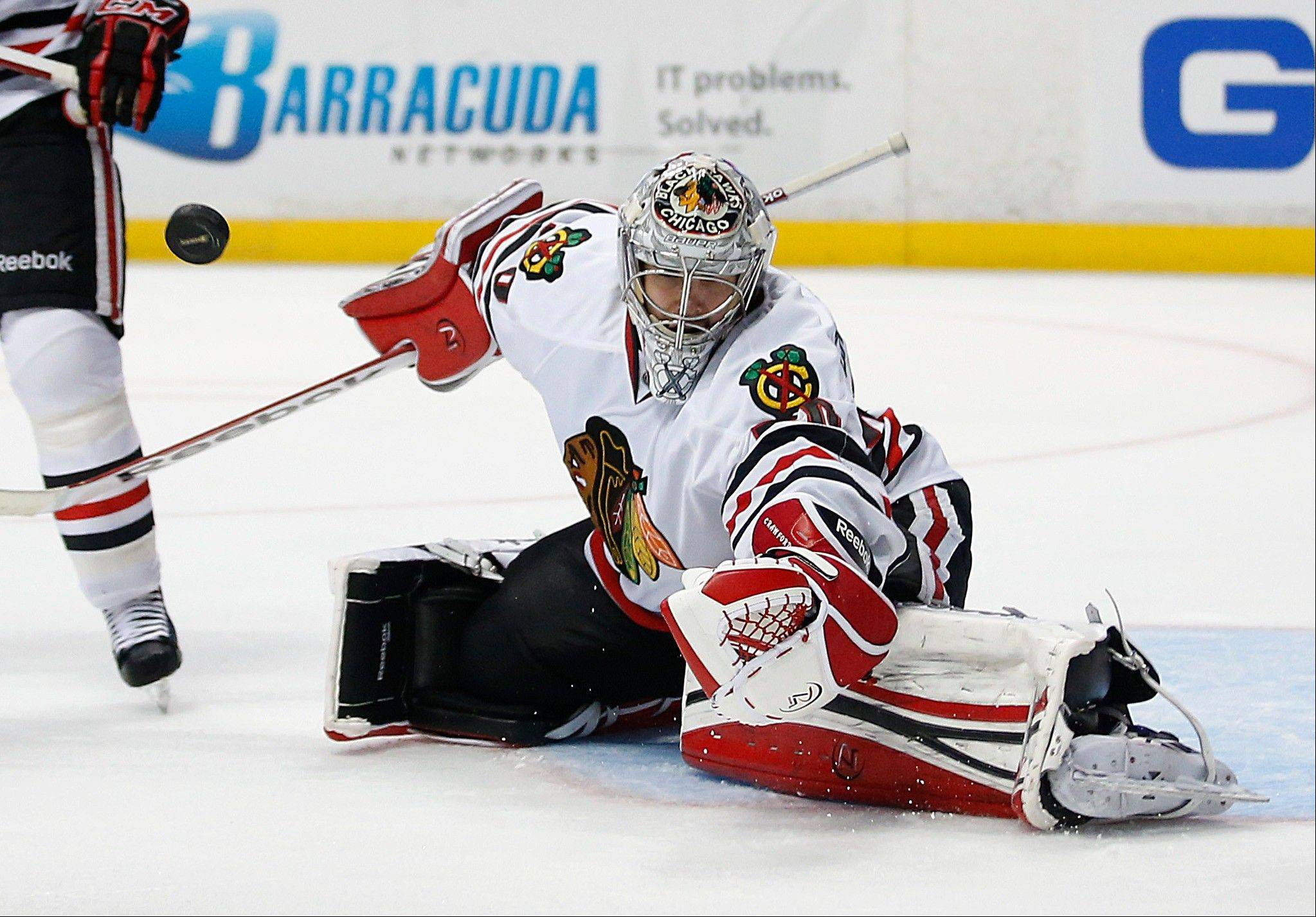 Chicago Blackhawks goalie Corey Crawford deflects a shot by the Anaheim Ducks during the second period.
