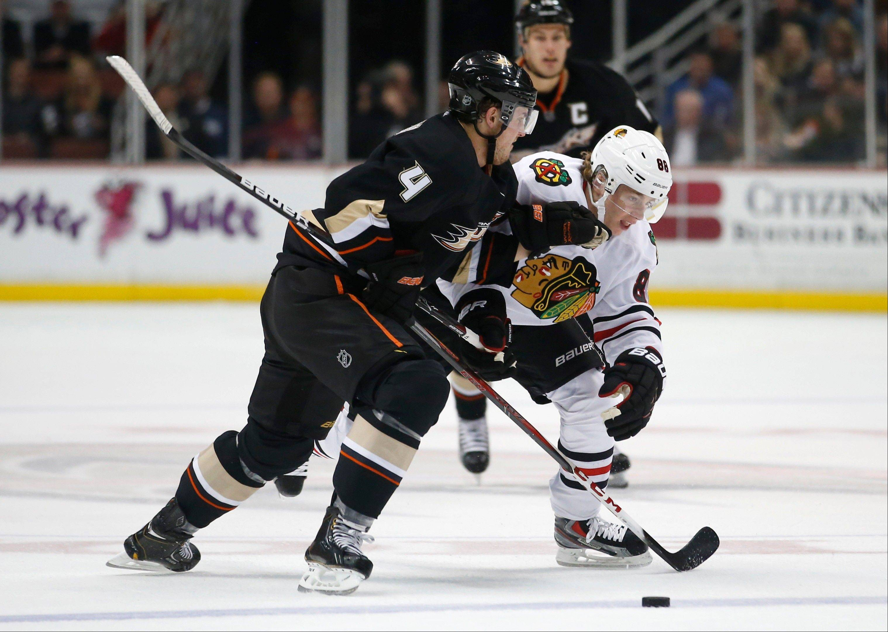 Chicago Blackhawks' Patrick Kane, right, is defended by Anaheim Ducks' Cam Fowler during the first period.