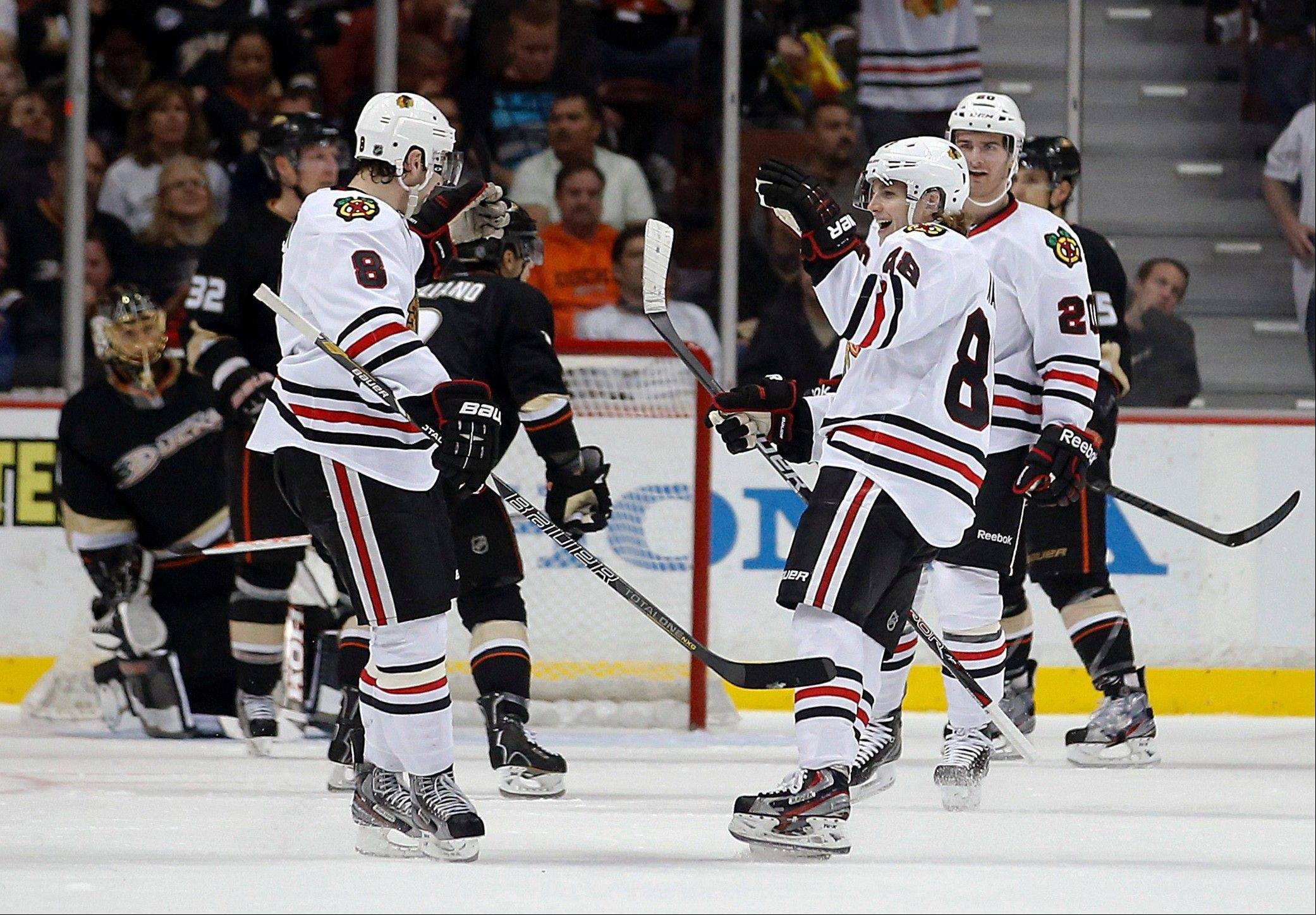 Chicago Blackhawks' Nick Leddy, left, celebrates his goal with Patrick Kane during the second period.