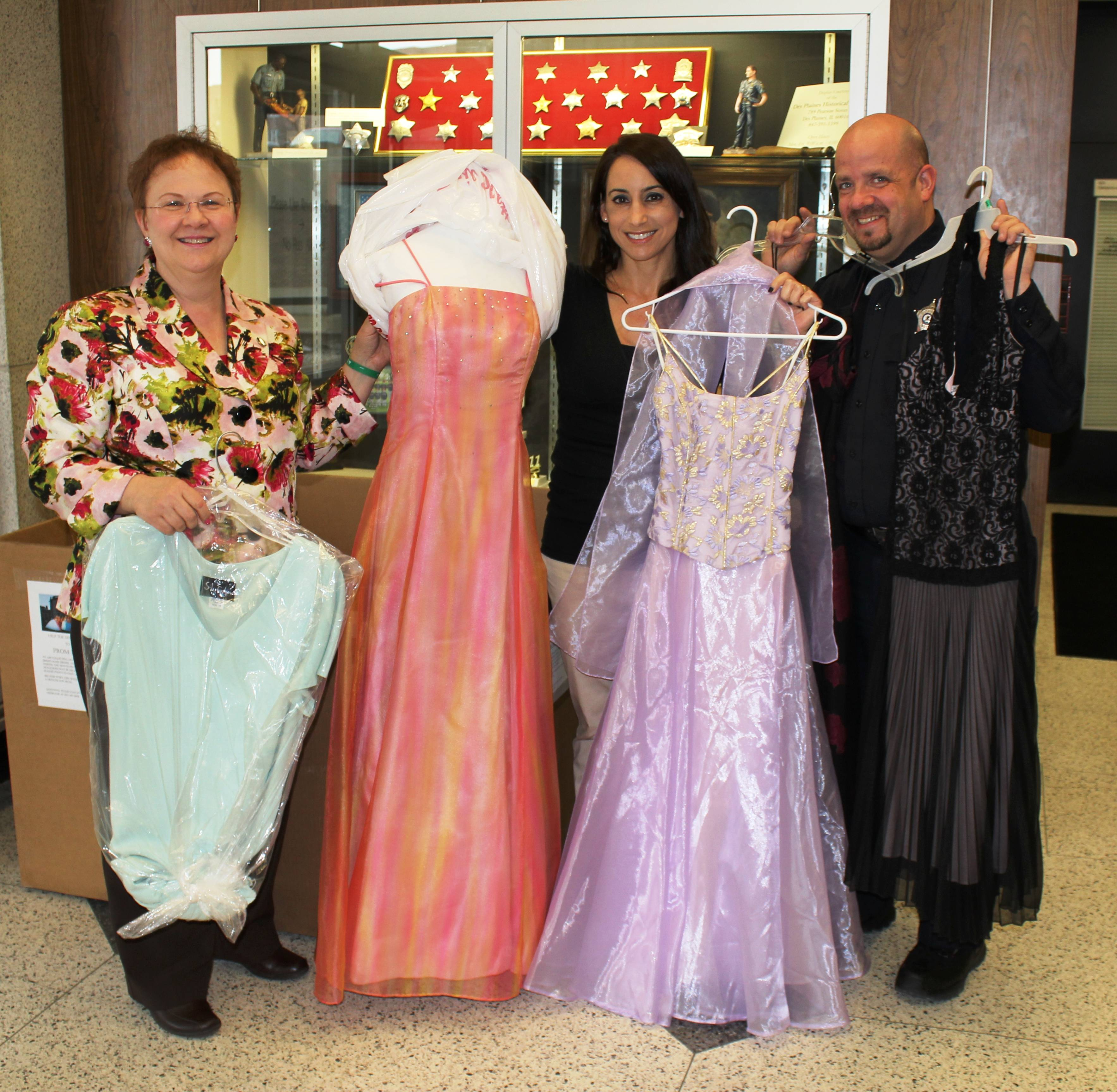 (pictured) Des Plaines City Clerk Gloria J. Ludwig (left), making a dress donation, poses for a photograph in the lobby of the Police Station with Detective Jennifer DePastors (middle) and Officer Michael Heidkamp (right), who is spearheading the Des Plaines Fashion Police: Prom Possible.