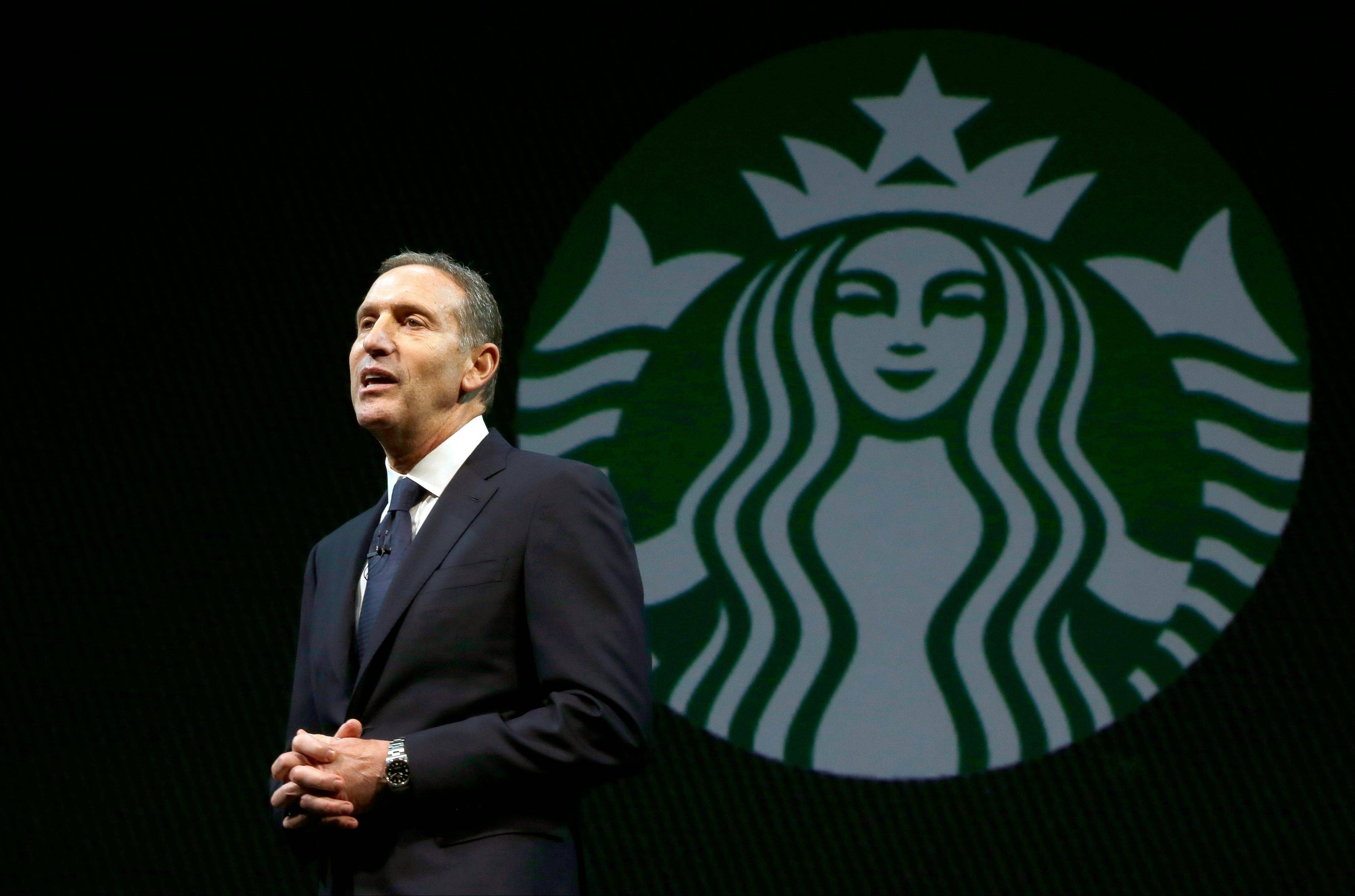 Starbucks CEO Howard Schultz speaks Wednesday at the company�s annual shareholders meeting.