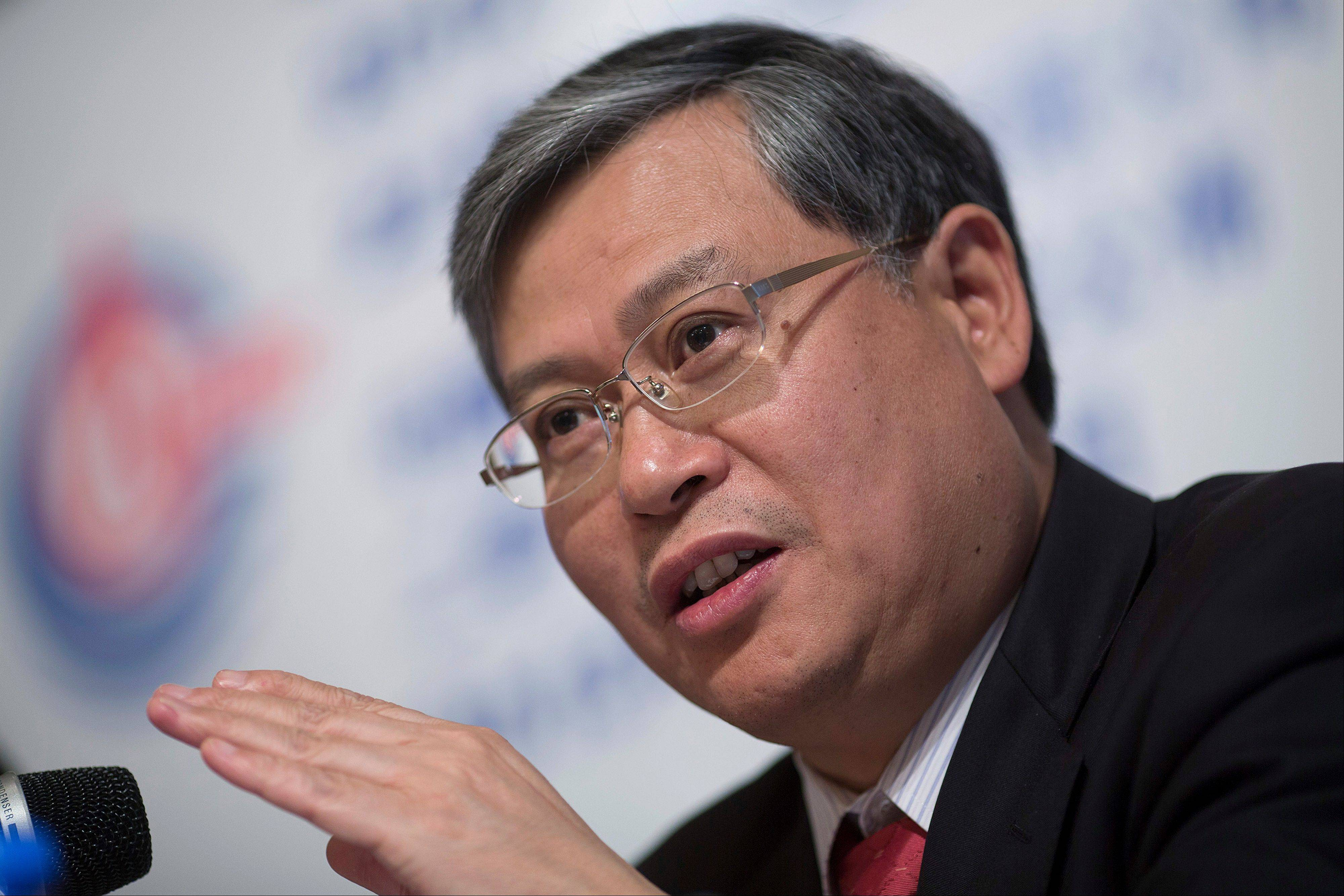 Li Fanrong, chief executive officer of CNOOC Ltd., gestures while speaking during a news conference in Hong Kong, China, on Friday, March 22, 2013. CNOOC reported 2012 profit that missed analyst estimates as China�s biggest offshore oil producer spent more to explore and revive stalled output growth.