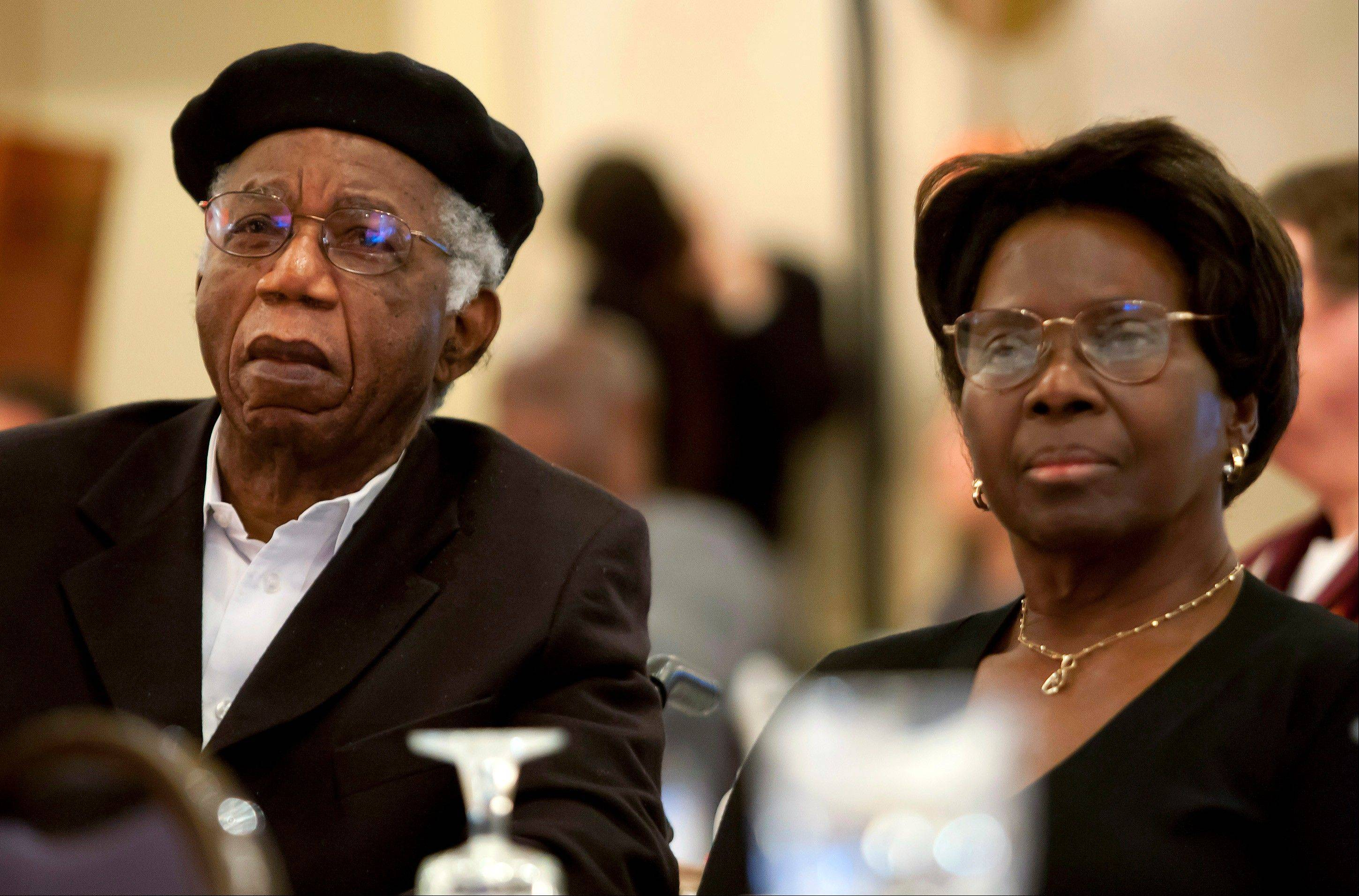 Chinua Achebe, left, with his wife Christie Achebe on campus in Providence, R.I.