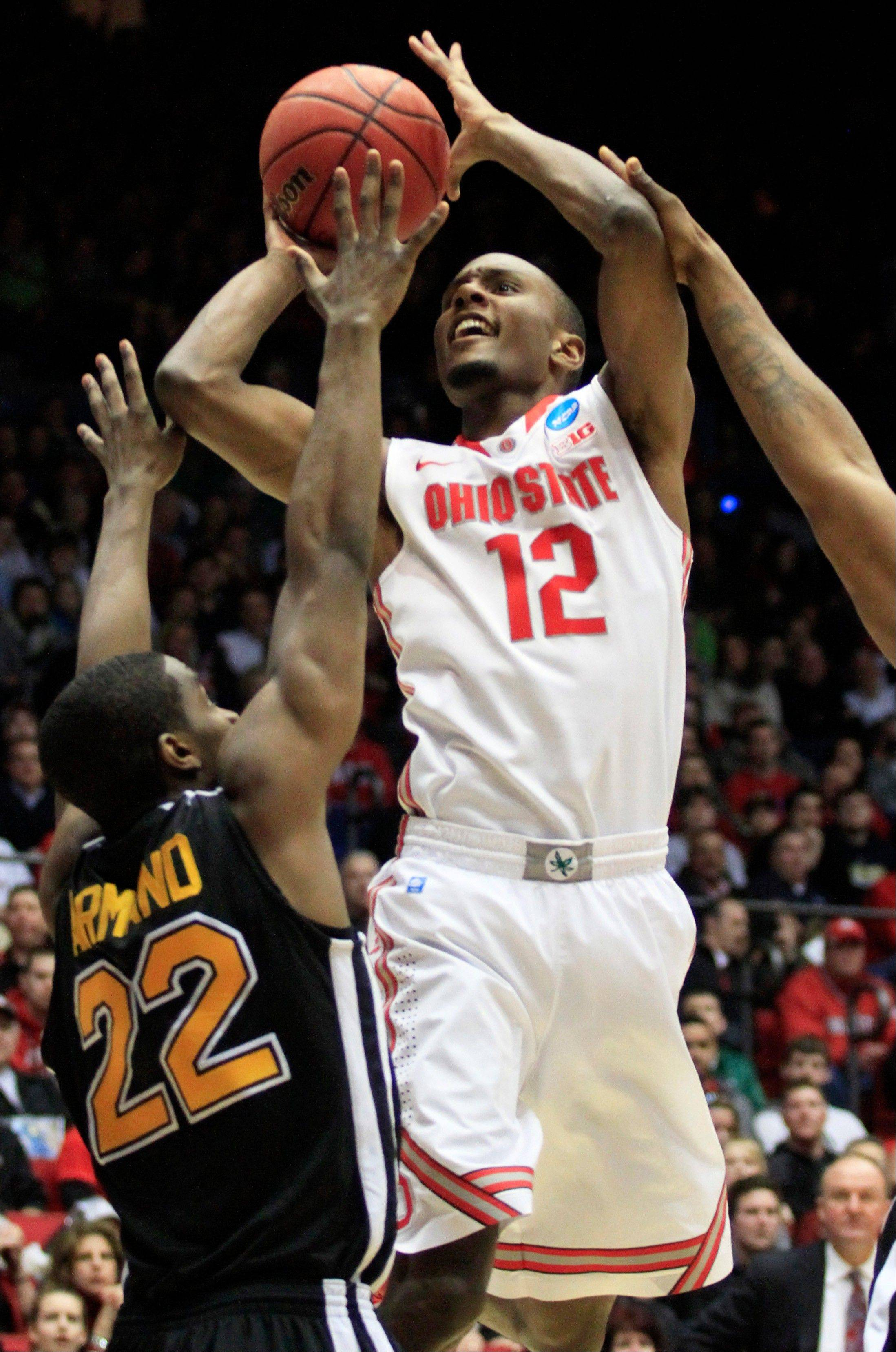 Ohio State forward Sam Thompson (12) shoots against Iona guard Sean Armand (22) in the second half of a second-round game at the NCAA college basketball tournament, Friday, March 22, 2013, in Dayton, Ohio. (AP Photo/Skip Peterson)
