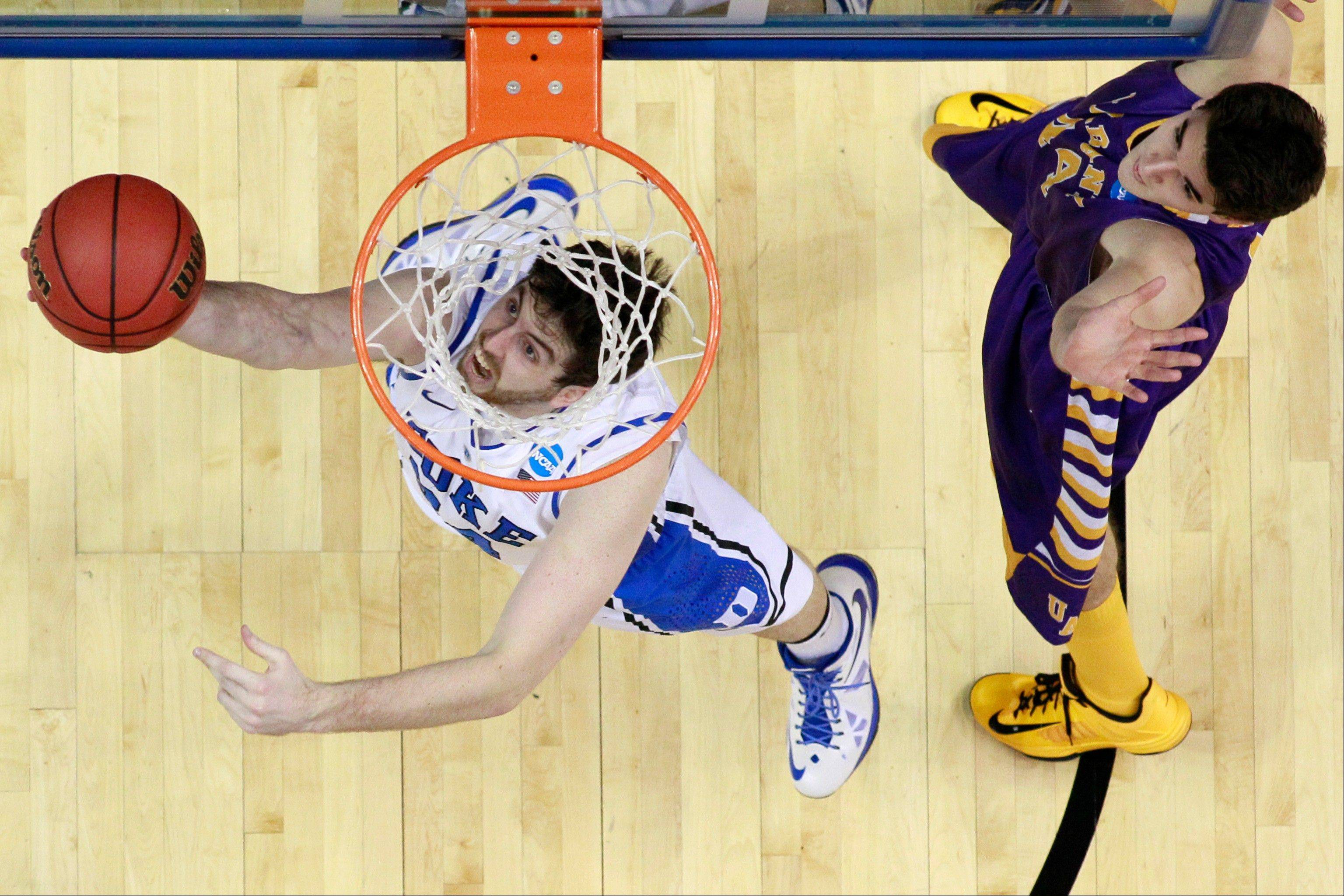 Duke's Ryan Kelly, left, goes up for a shot as Albany's John Puk defends Friday during the first half of a second round game of the NCAA tournament in Philadelphia.