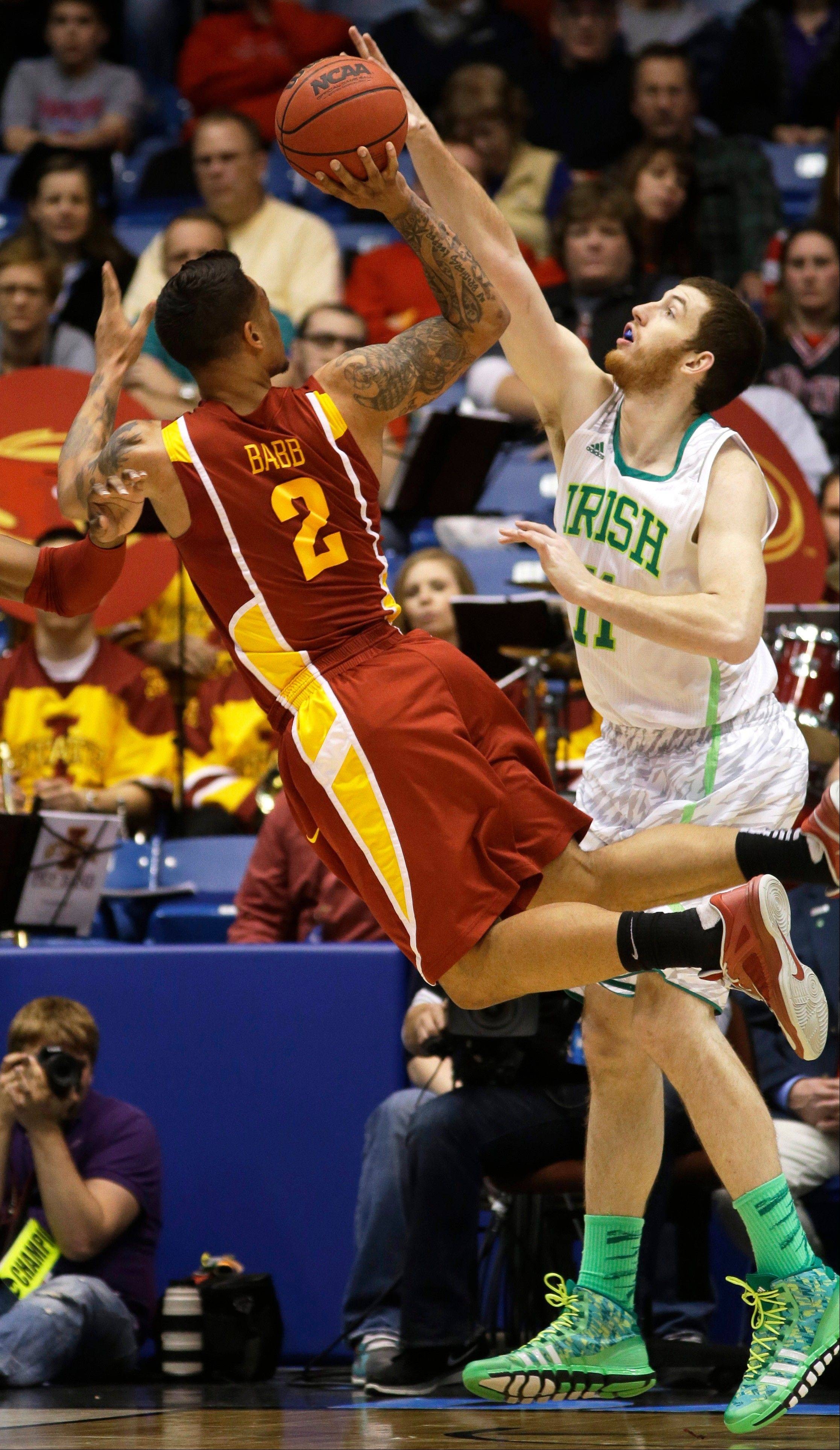 Iowa State guard Chris Babb (2) shoots against Notre Dame center Garrick Sherman (11) in the second half of a second-round game at the NCAA college basketball tournament on Friday, March 22, 2013, in Dayton, Ohio. (AP Photo/Al Behrman)