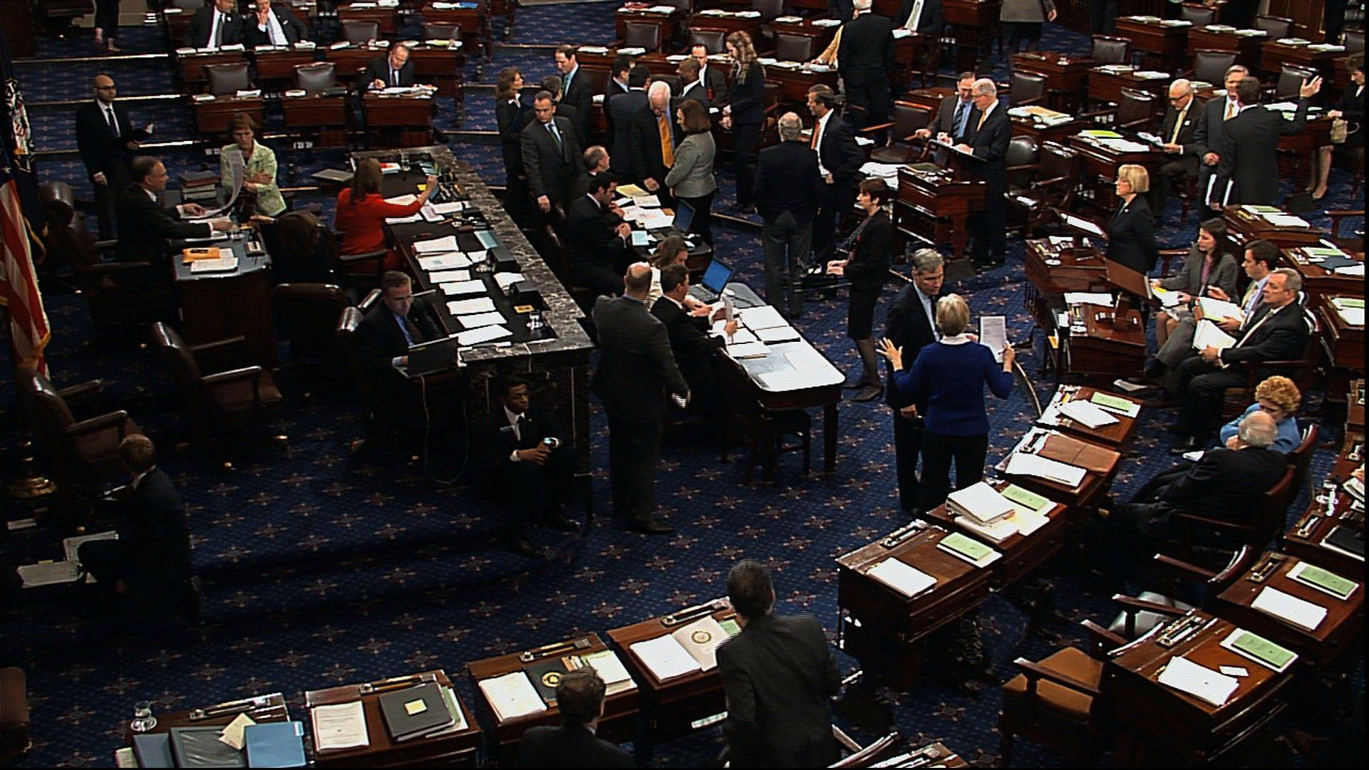 In this video image from Senate Television, senators speak Friday on the floor of the Senate during voting on an amendment to the budget resolution at the Capitolin Washington.